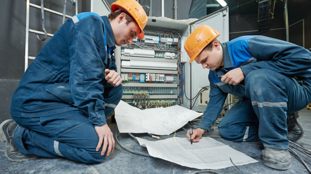 services-electrical-contracting-2-men-with-plans.jpg