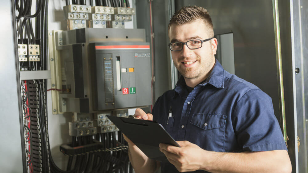 services-electrical-contracting-electrician-with-clipboard.jpg