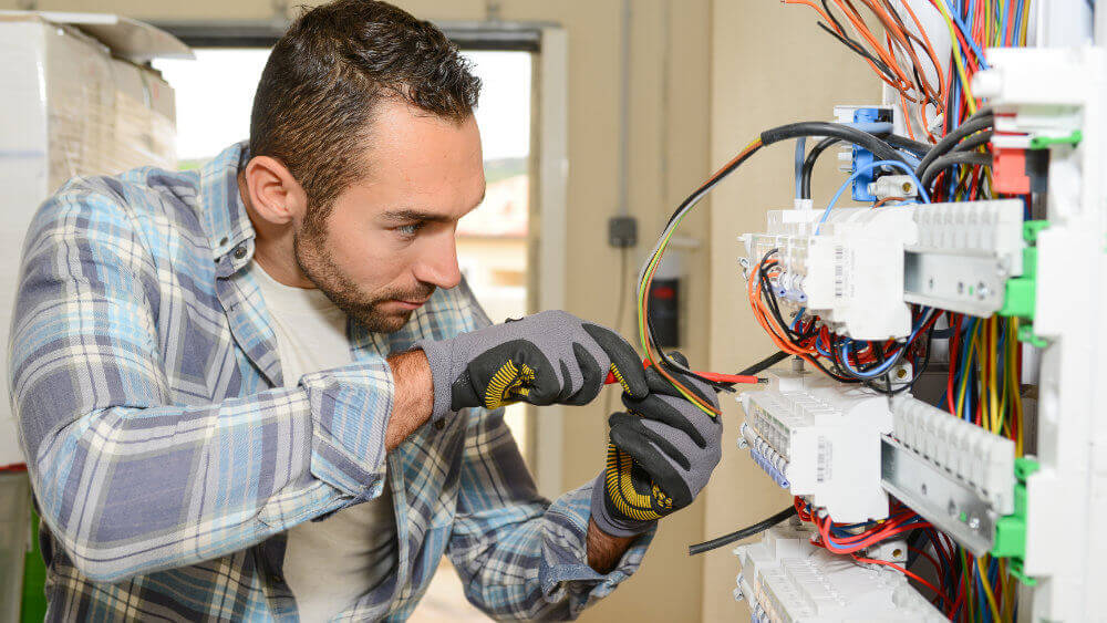 services-electrical-contracting-electrician-working-on-panel.jpg
