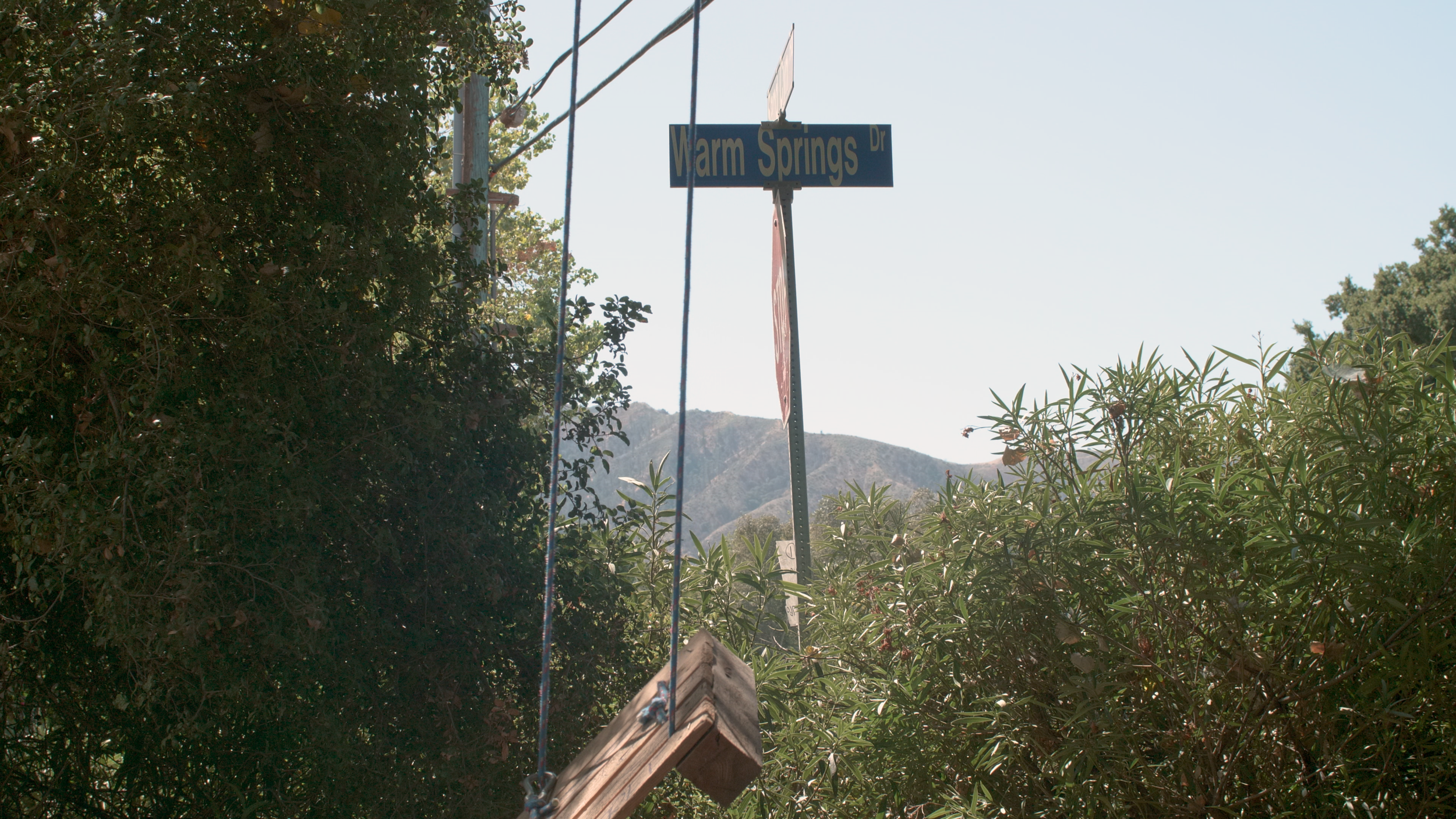 The swing set next to the street sign