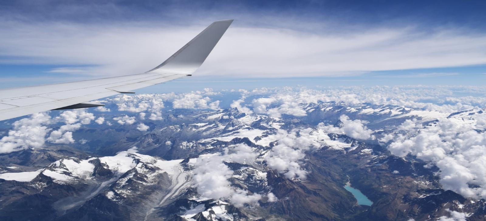 airplane wing blue skies