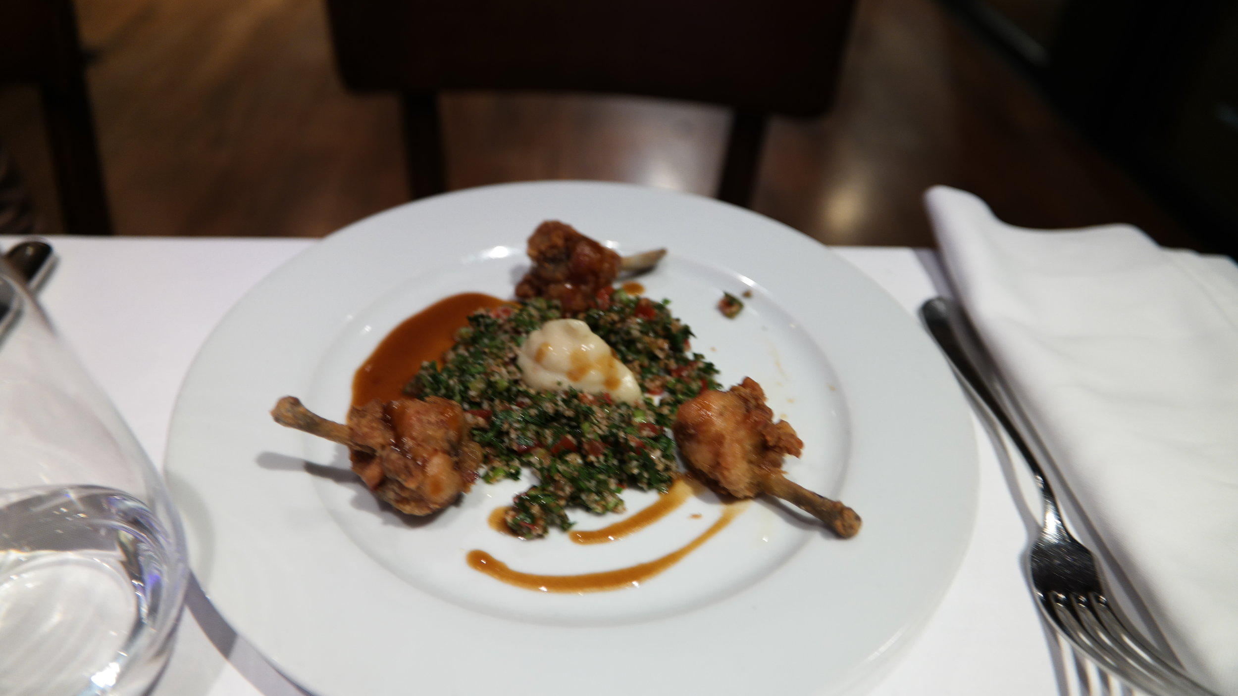 Chicken Lollipops, tabouleh, garlic puree and sauce corsé