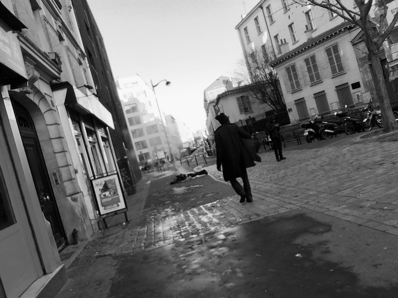 man_walking_lying_on_street_december_2017.jpg
