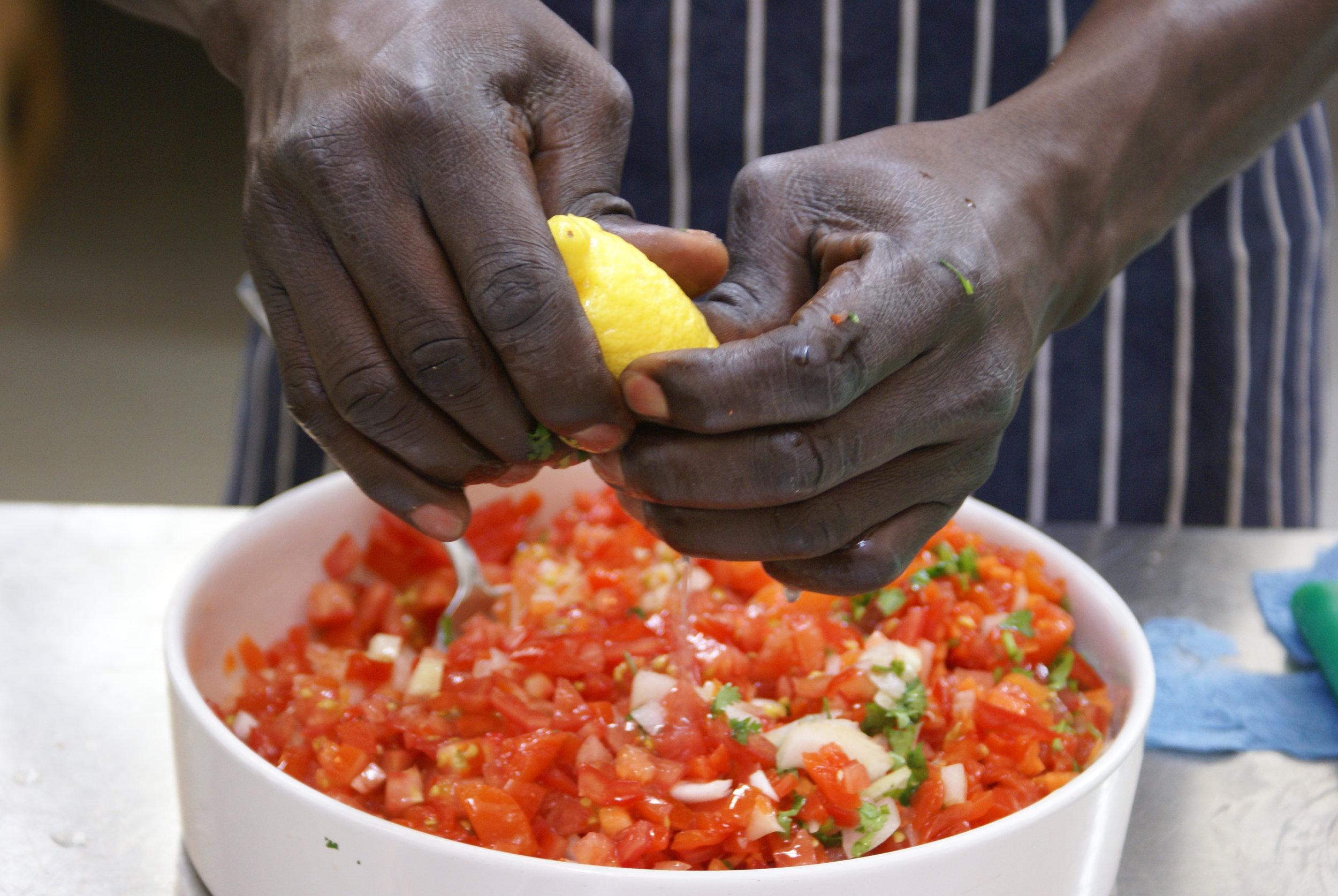 2016-sudanese-tomoto-salad-lemon-hands-kent.JPG