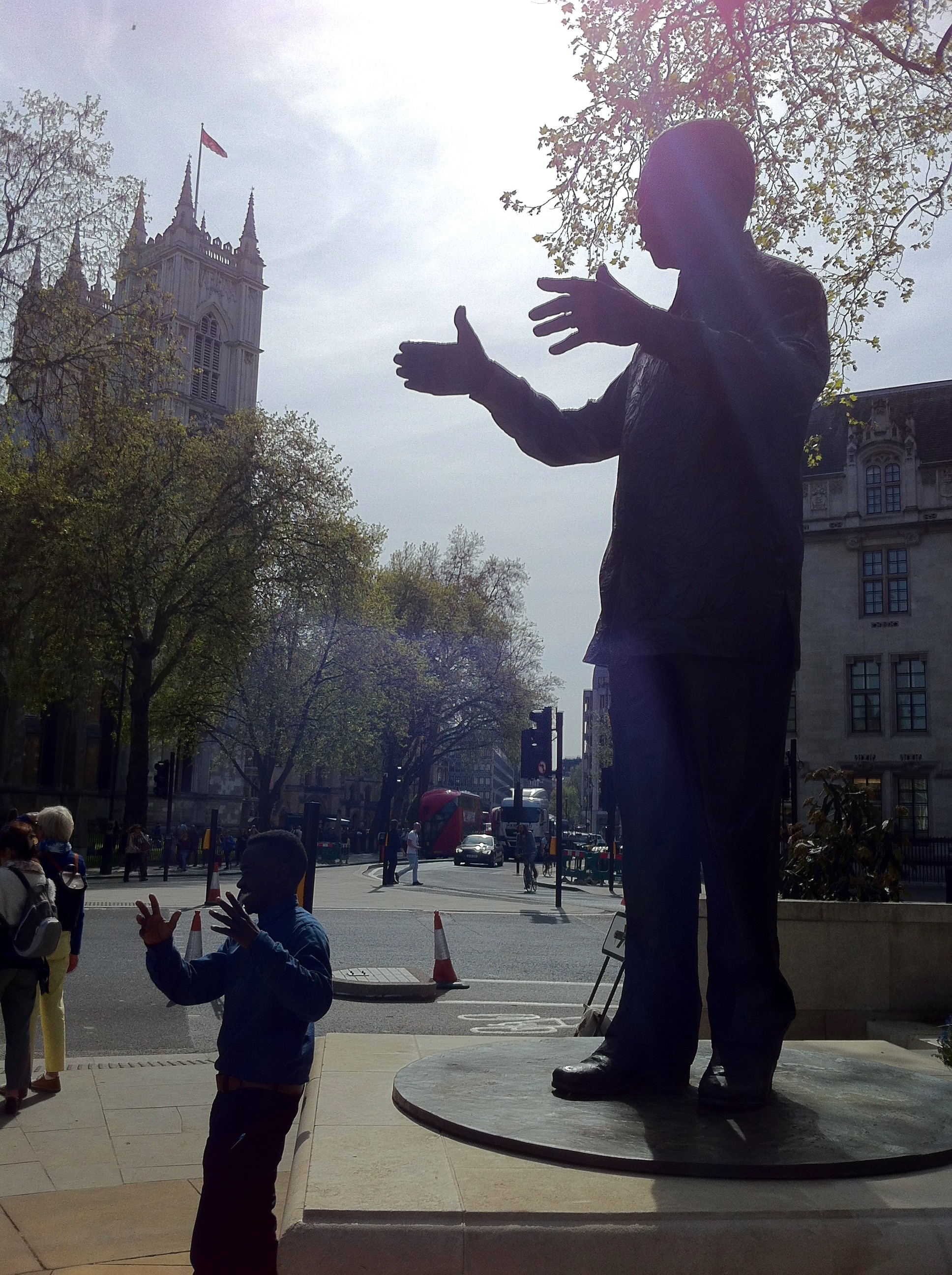 """In our hands"", photograph of Nelson Mandela in Parliament Square, UK on the day of a 'Calais' reunion in London, 2016. Photo credit: Emma Barrett Palmer"