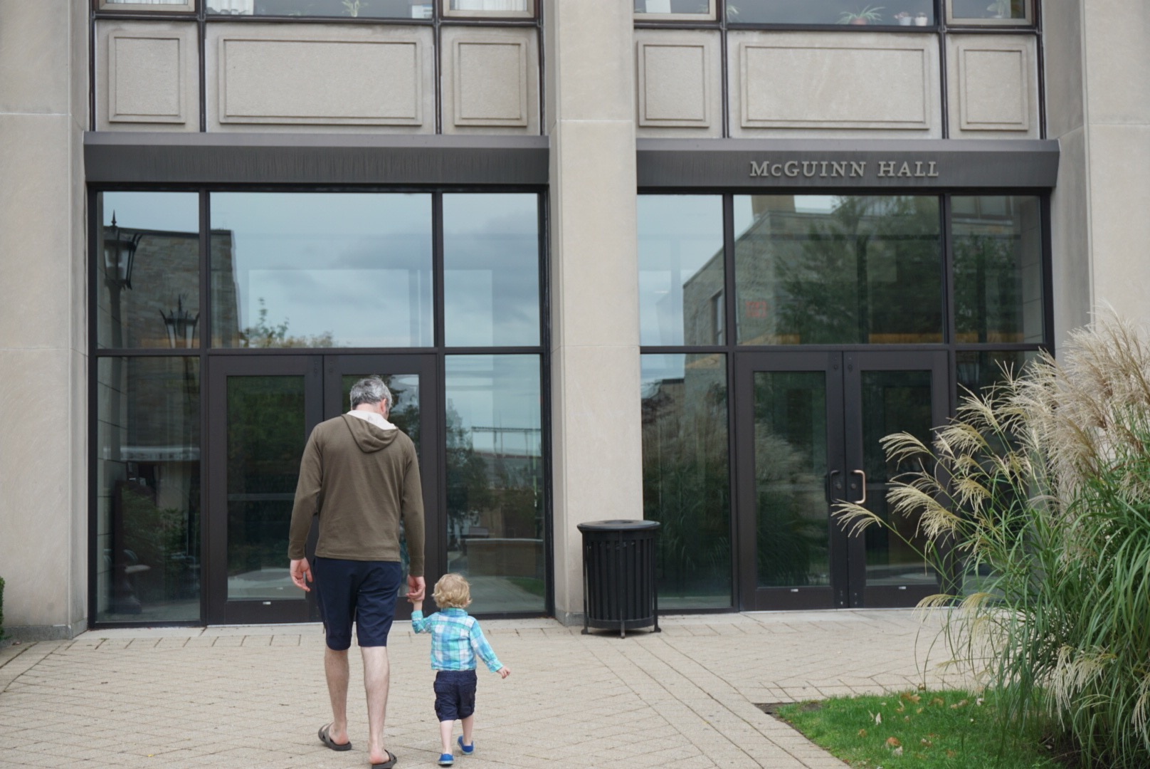 Leo and his Dad walk to McGuinn Hall from the Beacon Street Entrance.