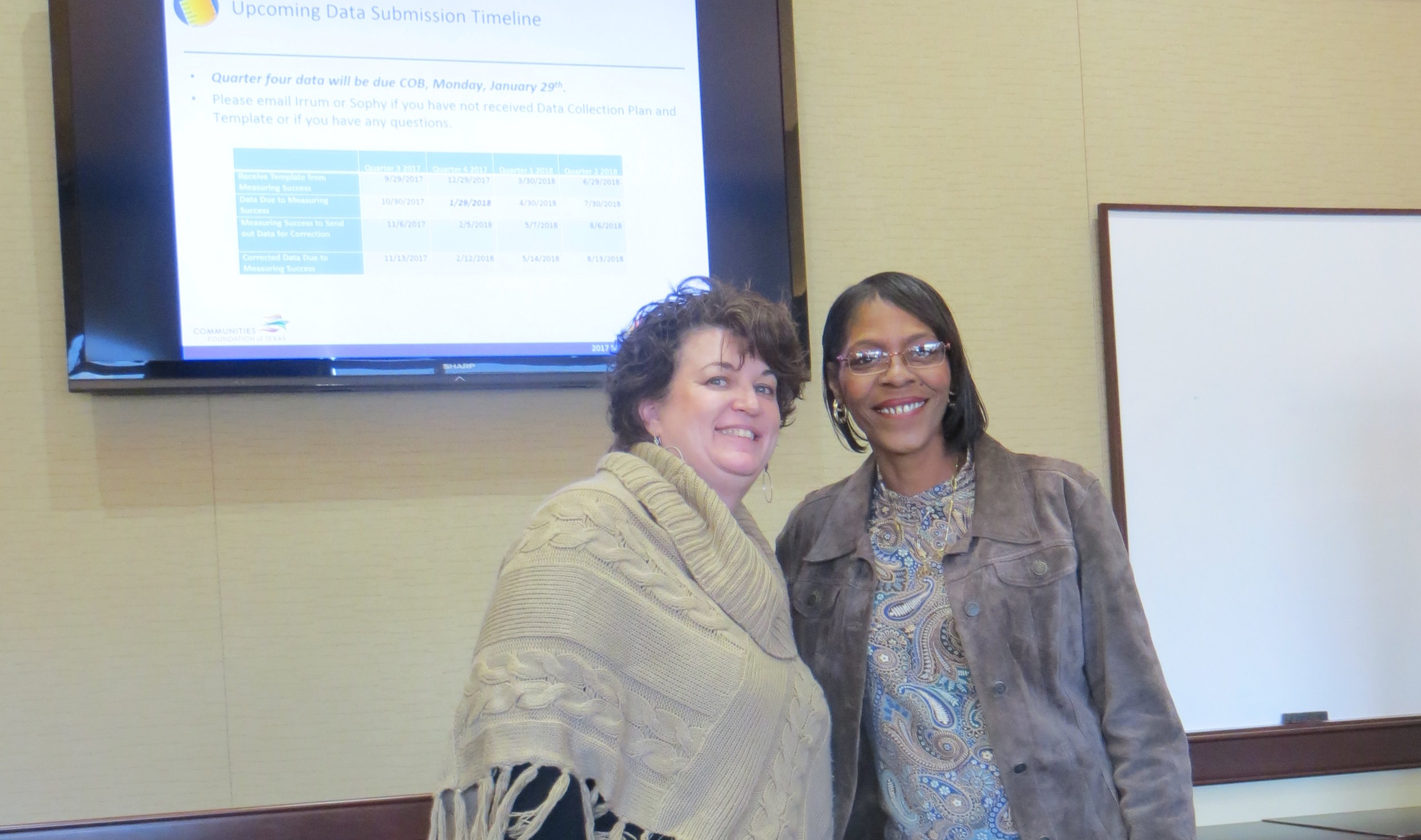 Vonda Harris, a BridgeBuilders achievement coach, with Wende Burton, CFT's Community Philanthrophy Director, after a recent cohort meeting.