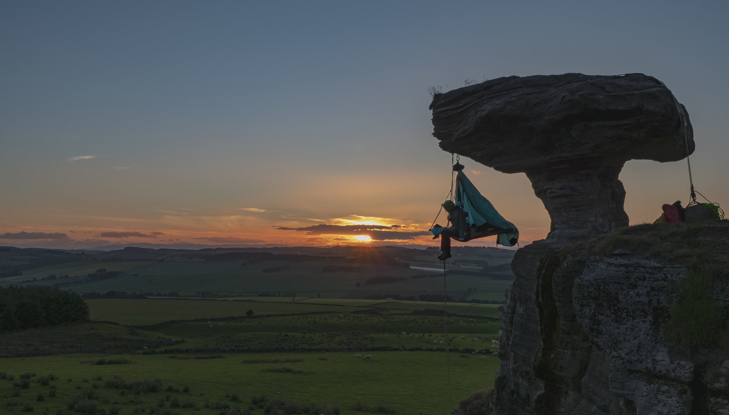 Phoebe Smith prepares to sleep suspended from the famous Bunnet Stane rock in Fife, Scotland