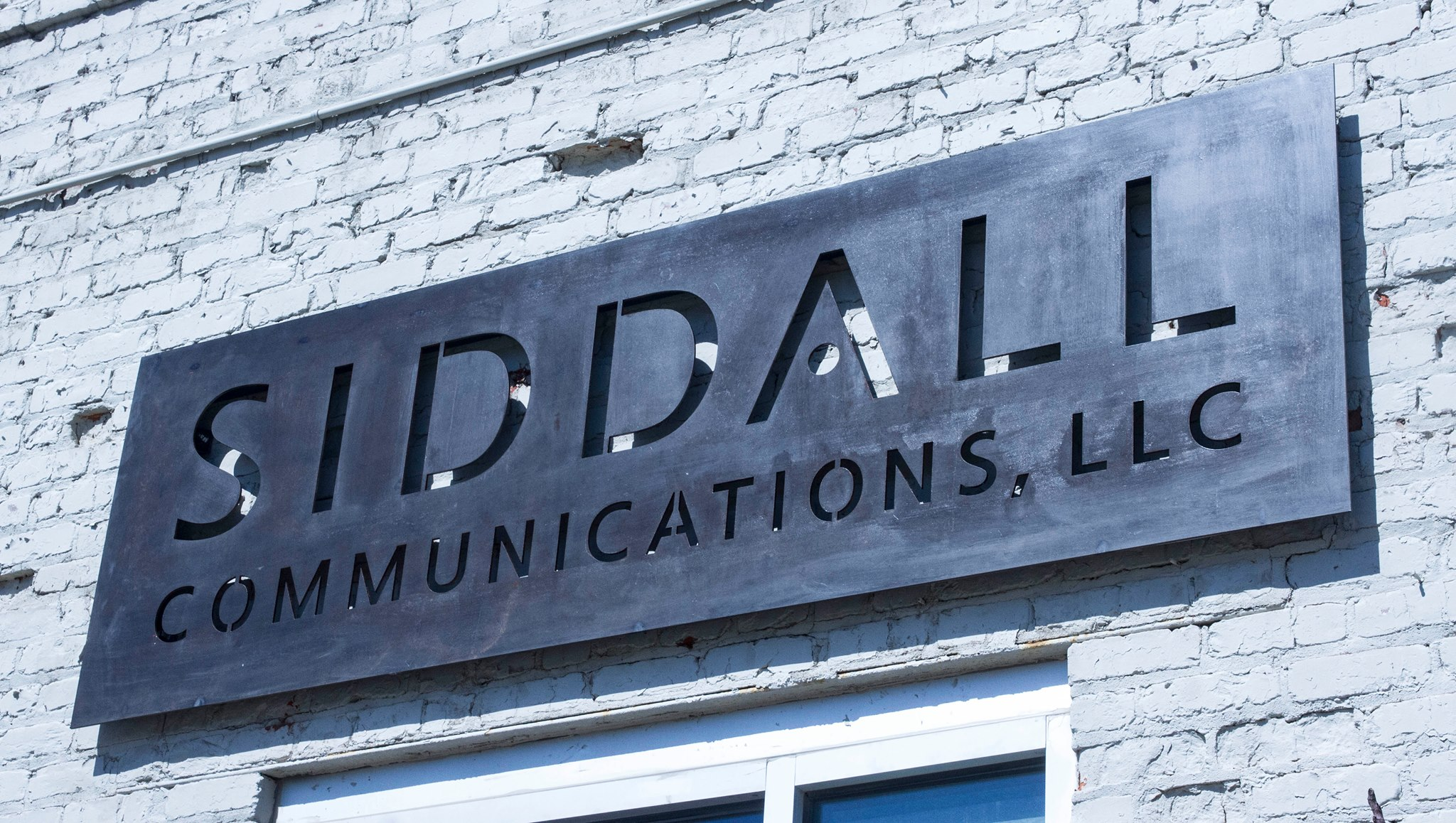 SIDDALL METAL SIGN
