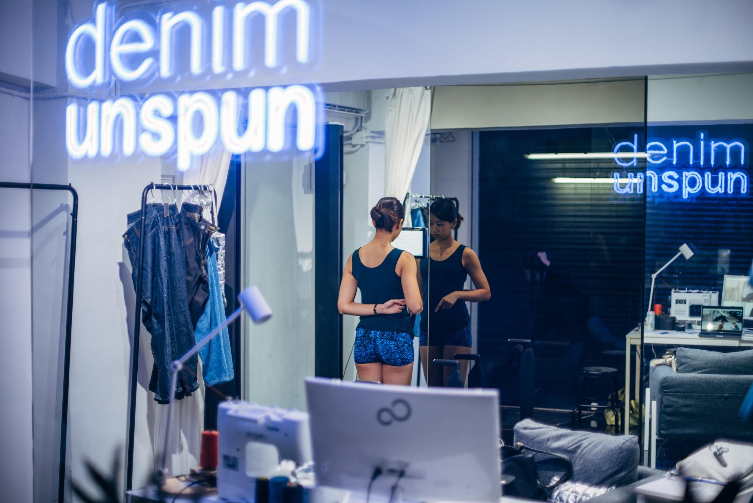 - when you come to an unspun pop-up, you are in for a new experience! unspun has flipped the current clothing model, instead starting the whole process with you. when you arrive at an unspun pop-up, you will be greeted with a drink, a chair, and some time to chat. we will tell you about how we are able to make your jeans specifically for you. then, we will take you through the 3d imaging process, which is painless and actually quite fun. this technology is what enables us to custom make jeans as if we were stitching around your actual body. the imaging system is comprised of infrared sensors and a rotating disk, which you will stand on. the whole thing takes less than a minute and gives you a ton of information (including 100,000 data points, turning you into a data cloud). this amount of information allows us to be both more efficient and more bespoke than a tailor.check out the scanner we use.