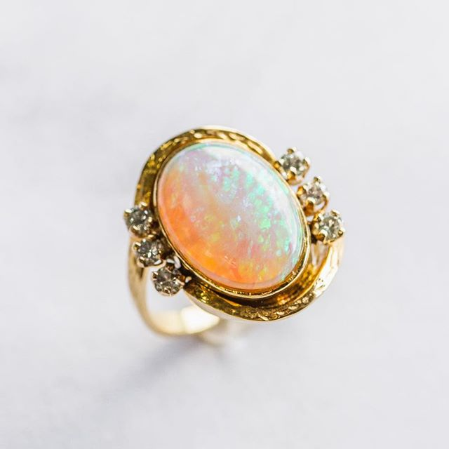 Hey October, babies! You have a really unique birthstone!! Opal's shifting play of kaleidoscopic colors is unlike any other gem- and no two opals are exactly alike! • Here pictured is a white opal that has a wide play-of color.  It refracts greens, blues, purples, yellows AND oranges!! • Keep an eye out for our future posts this month as we share other varieties of opals!! Don't forget to tag your loved ones who have a birthday this month too! - - - #mbrichjewelry #lakecharles #opal #october #whiteopal #playofcolor #octoberbirthstone #birthstone #yellowgold #diamonds #finejewelry #opalring #supportlocal #visitlakecharles #jewelry #fashion #style