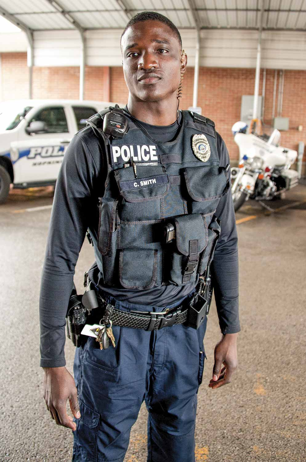 Hopkinsville Police Officer Cory Smith, one of the agency's newest K-9 handlers, also wears an external load bearing vest. The police department sought this particular style of vest for their officers in an effort to reduce the cost associated with officer injuries and fatigue as well as to promote a healthier environment and increase officer wellbeing. (Photo by Jim Robertson)