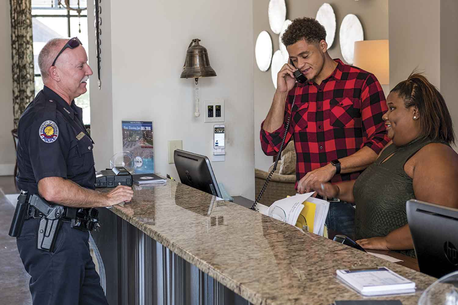 UofL Police Resource Officer Dion Dodson checks in with one of seven affiliate residence complexes near UofL's campus. Though geared toward university students, these affiliate locations also contain non-student residents and consume the bulk of Dodson's assigned area. (Photo by Jim Robertson)