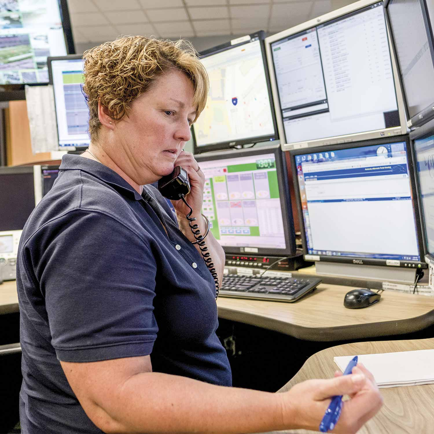 April Thompson is one of nine telecommunicators who serve the UofL dispatch center, which is a fully-operational center with a computer-aided dispatch system tied into Louisville Metro police and six other local agencies' systems. (Photo by Jim Robertson)