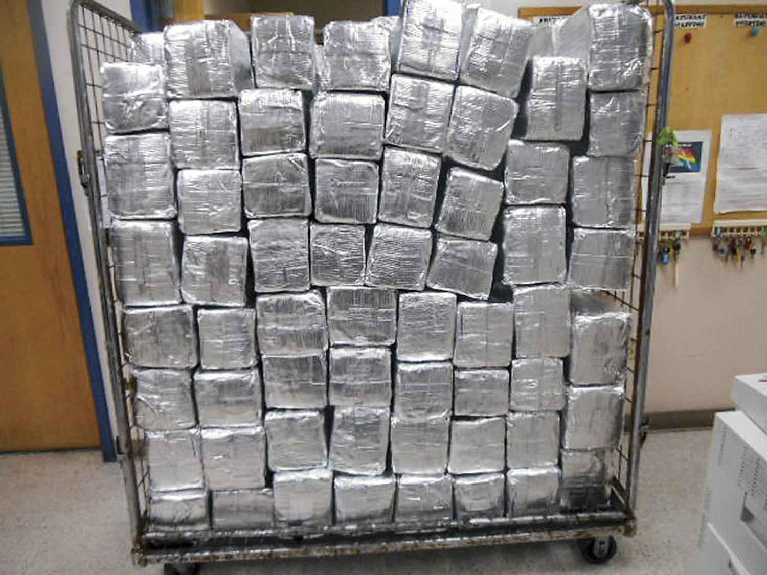 Texas U.S. Customs and Border Protection officers seized over half a ton of alleged marijuana in a commercial shipment of mud floor tiles. Packages containing 1,303 pounds of marijuana were seized. (Photo courtesy of U.S. Customs and Border Protection)