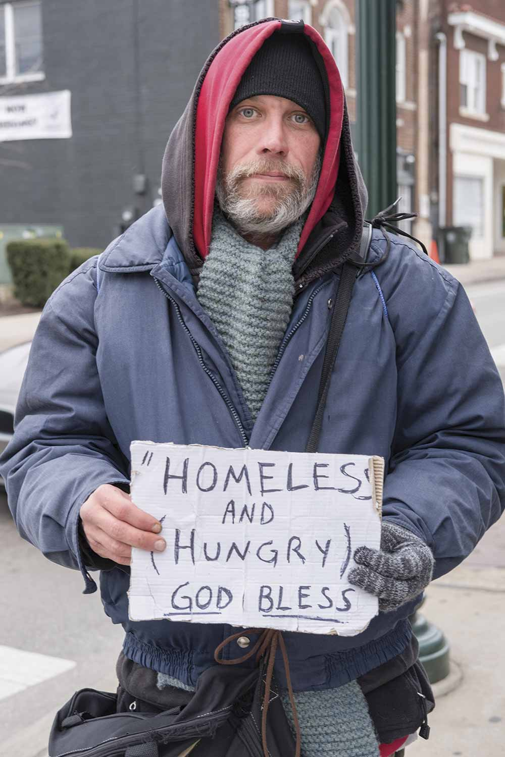 The city of Lexington attempted to control panhandling through a local ordinance, but the Kentucky Supreme Court recently struck down the measure, saying it violates free speech. Finding a balance between keeping beggars away from businesses and being compassionate to those in need is a struggle, officers say. (Photo by Jim Robertson)