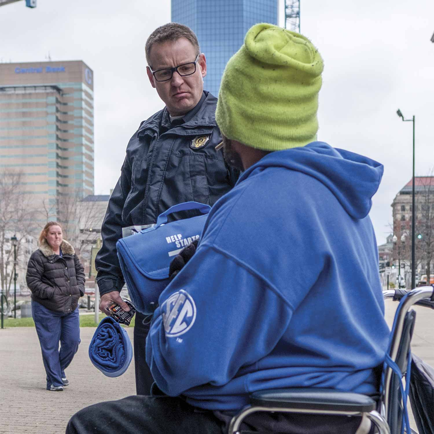Lexington Police Officer Howard Florence (below), speaks to a homeless individual in downtown Lexington. Working most of his time in downtown, Florence regularly encounters homeless residents in need of assistance. (Photo by Jim Robertson)