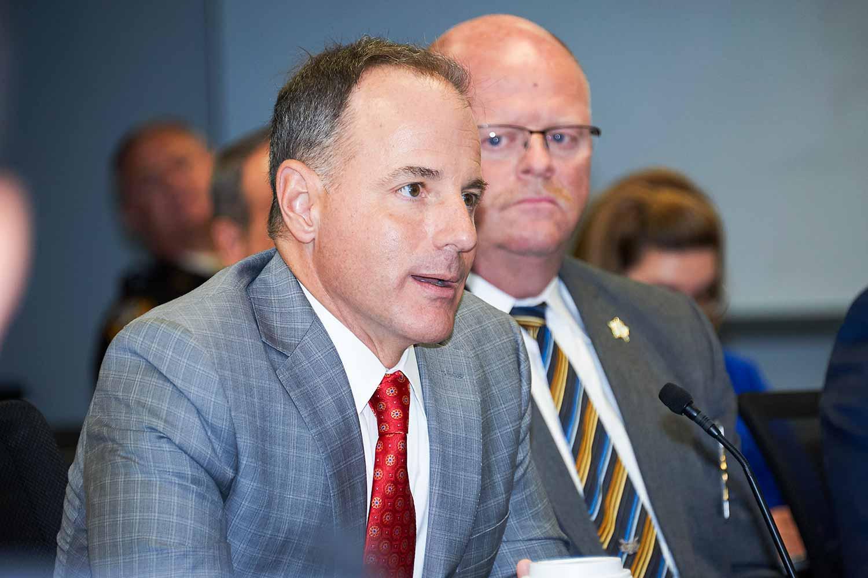 House Rep. Robert Benvenuti discusses HB 416 with legislators and Kentucky law enforcement leaders.(Photo by Jim Robertson)