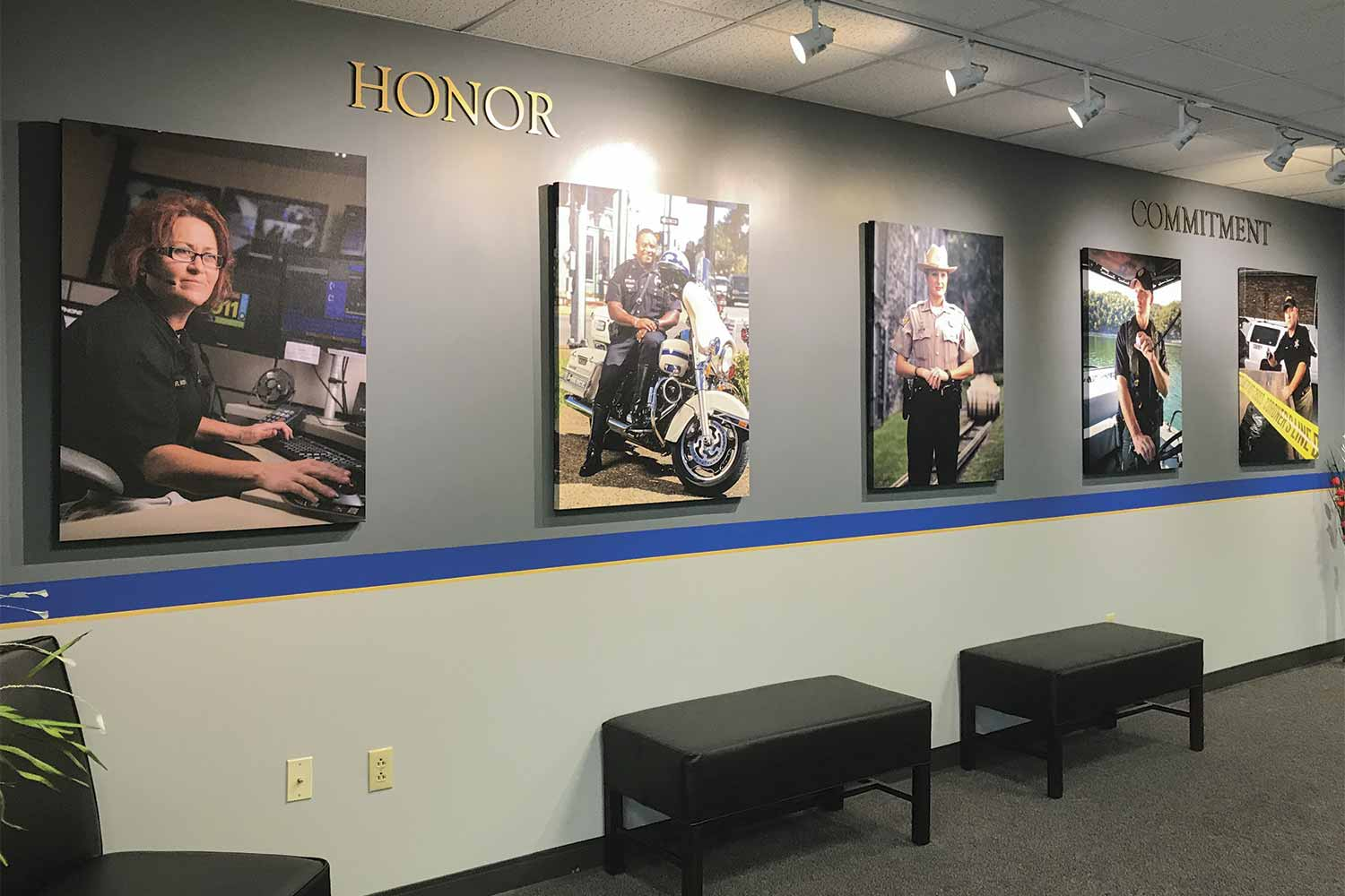 Portraits from left represent dispatchers, police, sheriffs, state law enforcement agencies and coroners - all clients served by DOCJT. Their photos are prominently displayed in the Funderburk lobby as a reminder of what's most important in training. (Photo by Kevin Brumfield)