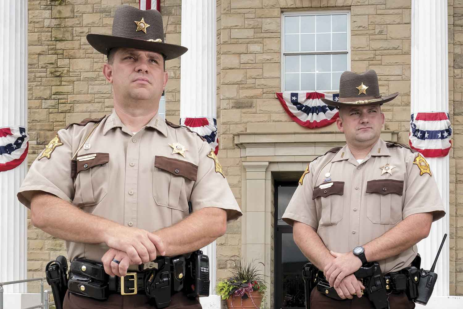 Lewis County Sheriff Johnny Bivens, left, pictured with Deputy Matt Ross in front of the courthouse, said his four deputies provide 24/7 coverage for the residents of the northeastern Kentucky county that boarders Ohio. (Photo by Jim Robertson)