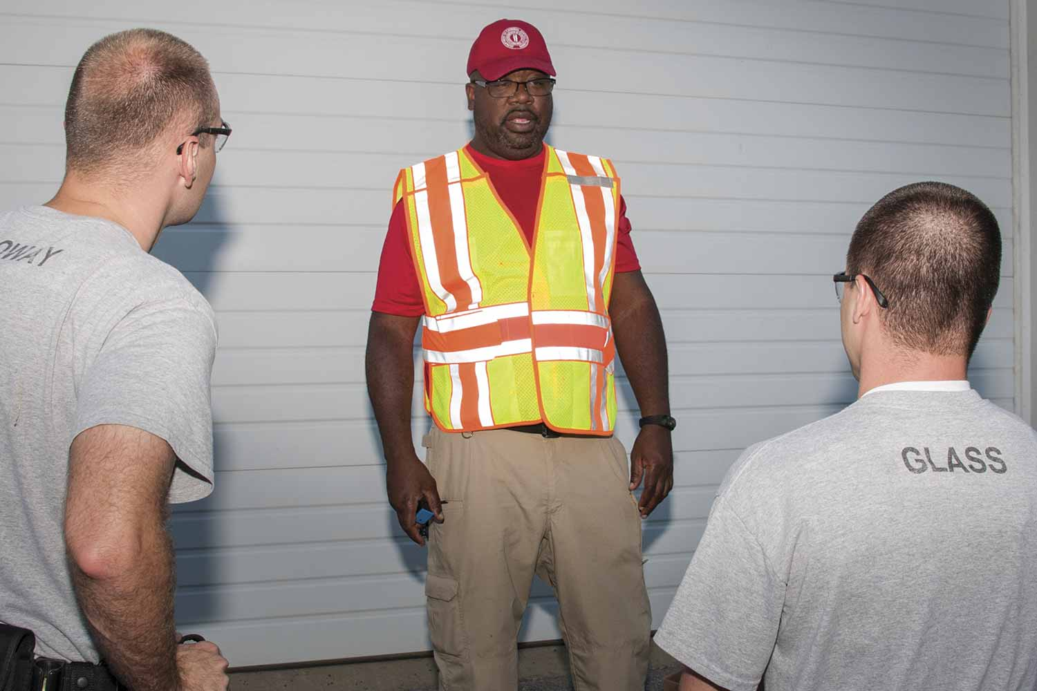 Department of Criminal Justice Training Instructor Shawn Maxie, center, speaks with DOCJT Basic Training Class 486 members Caleb Holloway, left, from the Owensboro Police Department, and Zane Glass with the Franklin Police Department during the Patrol: Counter-Ambush Practical Exercises course taught in October. (Photo by Jim Robertson)
