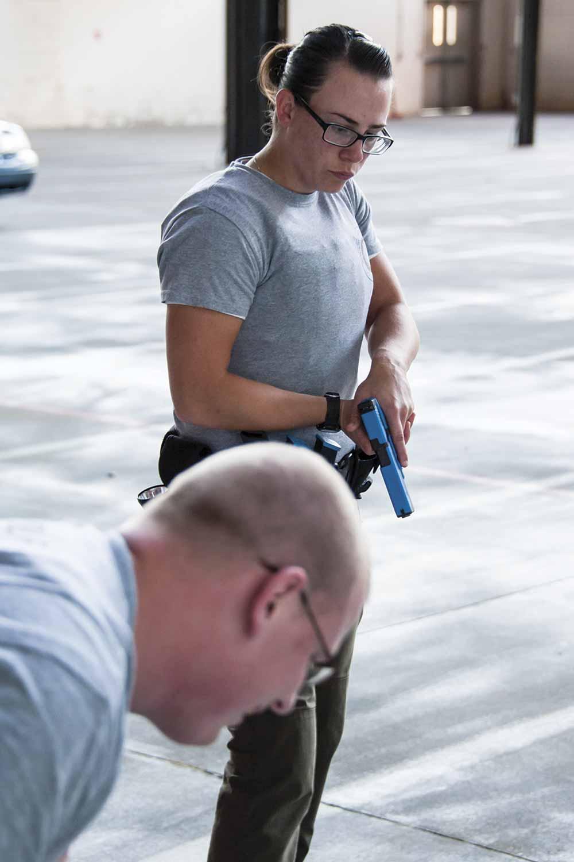 DOCJT Basic Training Recruit Kristina Huebner, with the Boone County Sheriff's Office, surveys the scene during the October ambush training. (Photo by Jim Robertson)