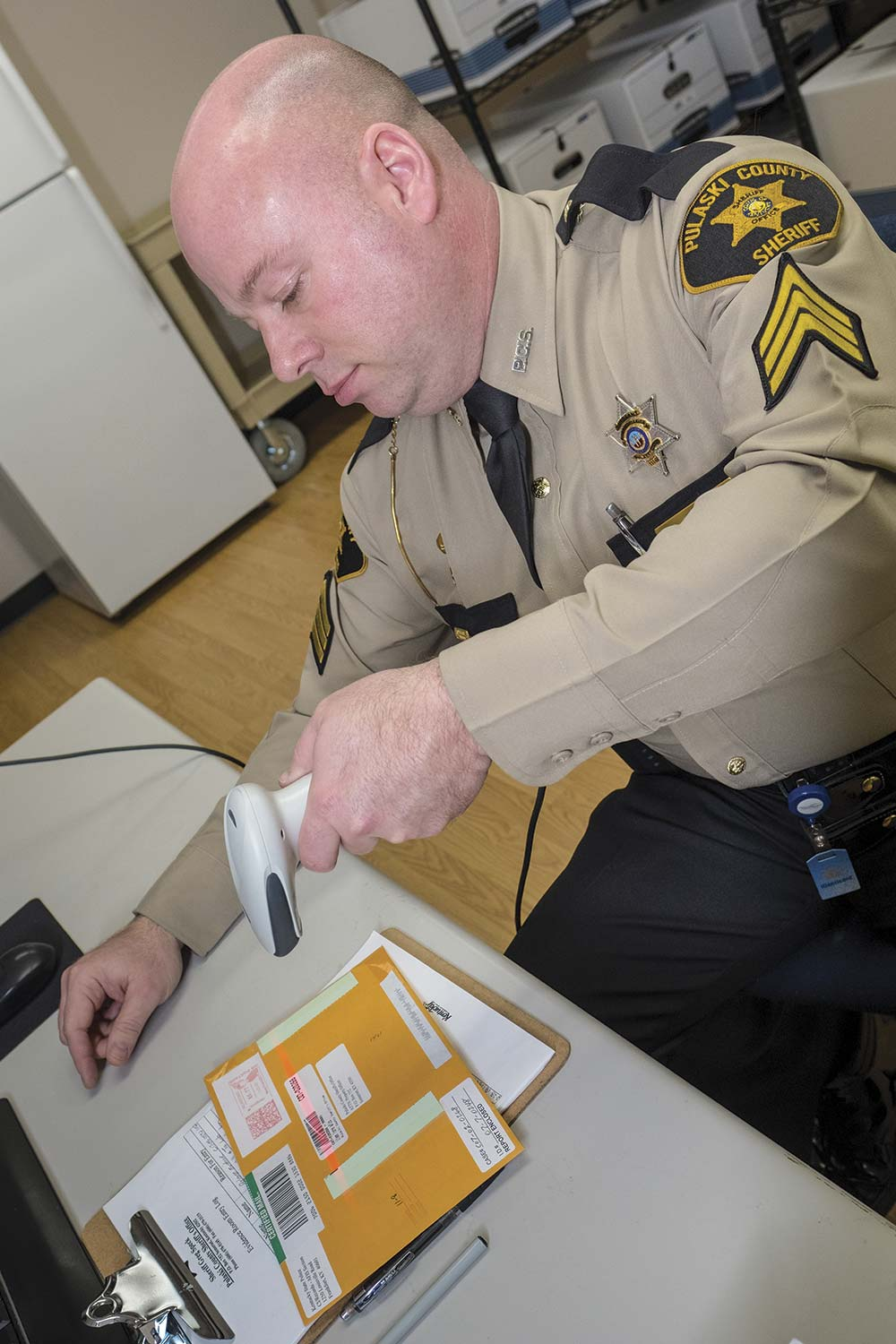 Pulaski County Sheriff's Sgt. Glen Bland said a modern digital tracking program helps with property and evidence management and is much more reliable than a hand-written log. (Photo by Jim Robertson)