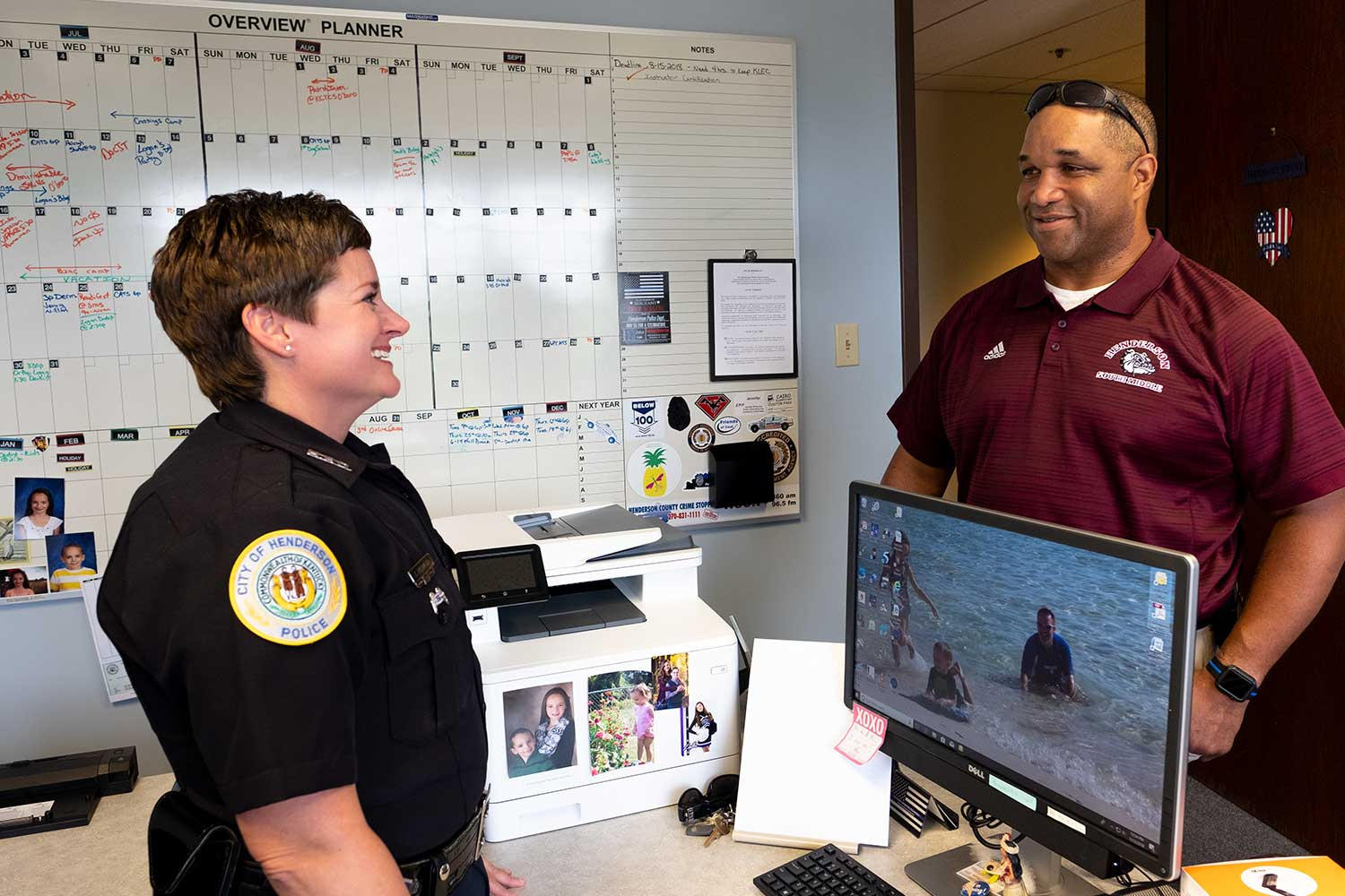 Henderson Police Officer Jennifer Richmond talks with Maj. Jermaine Pointer in her office at the Henderson Police Department.