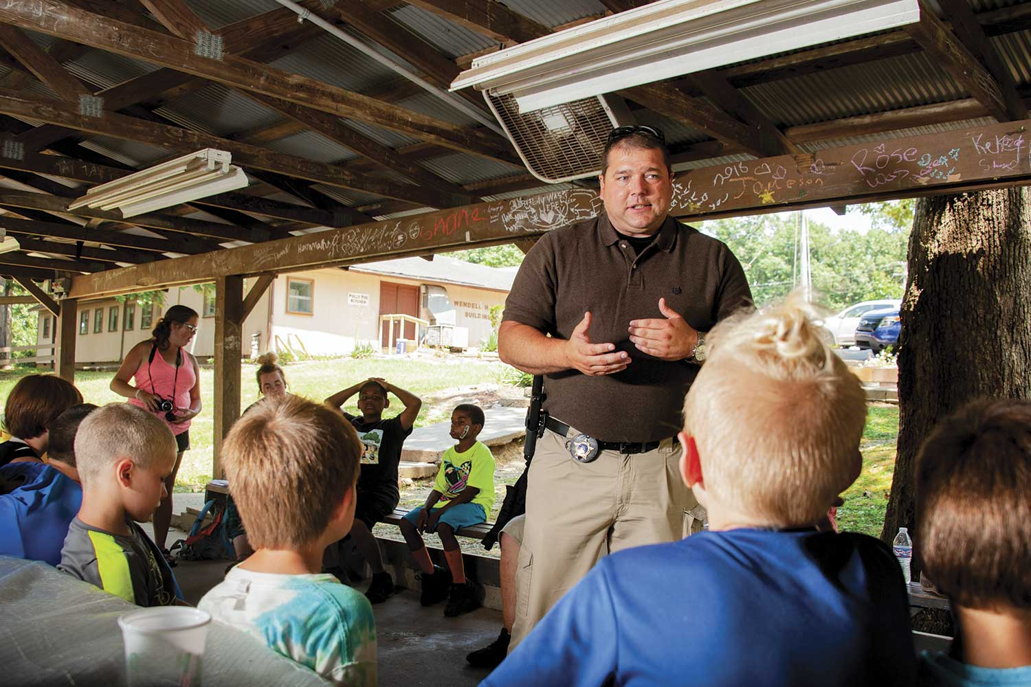 Marshall County Sheriff's Office Detective William Strader speaks to campers about D.A.R.E. in mid-July at the Kentucky Sheriffs' Boys and Girls Ranch. (Photo by Jim Robertson)
