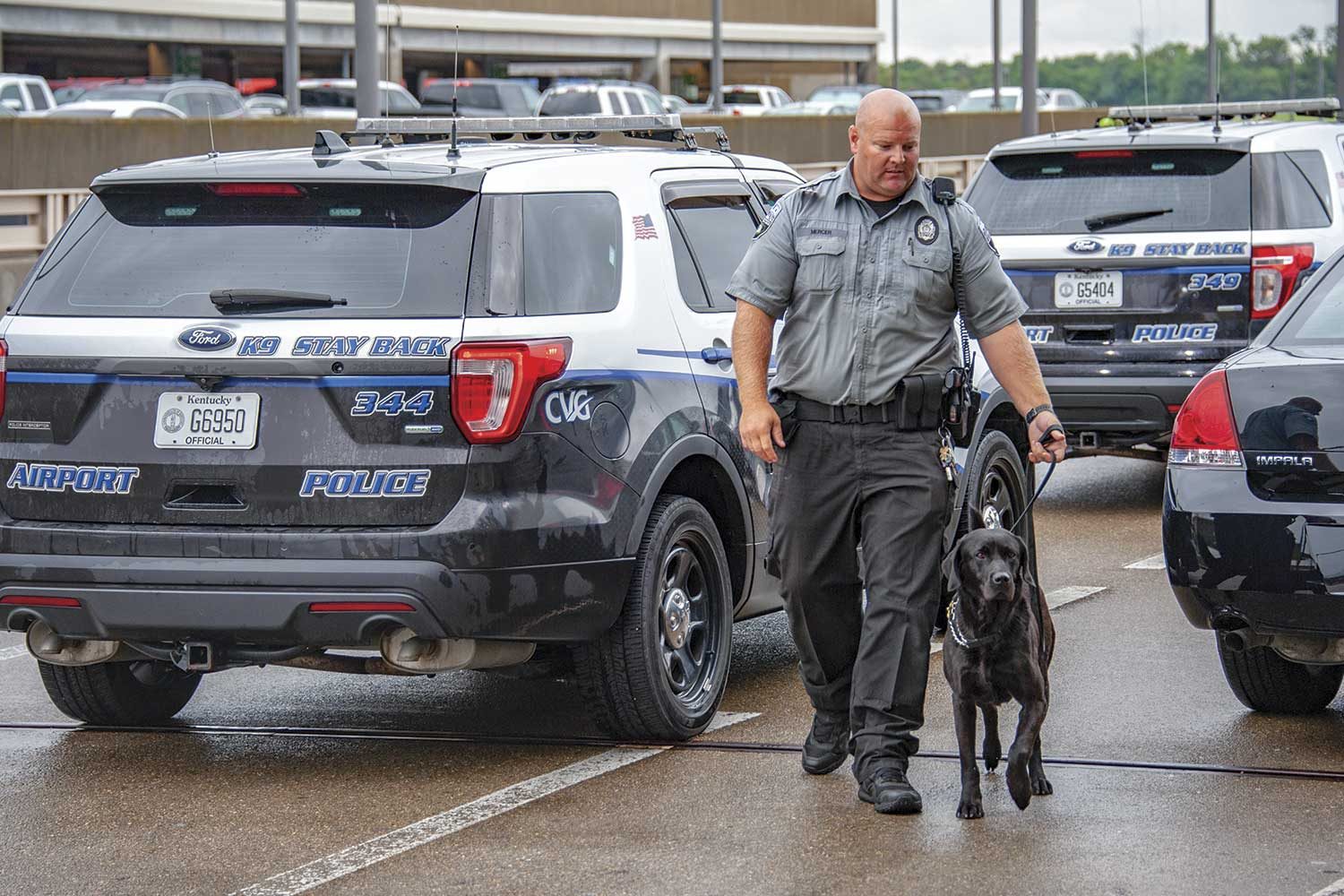 Cincinnati-Northern Kentucky Airport Police Officer Matt Mercer and K9 Jet prepare to go inside the main terminal for patrol. (Photo by Jim Robertson)