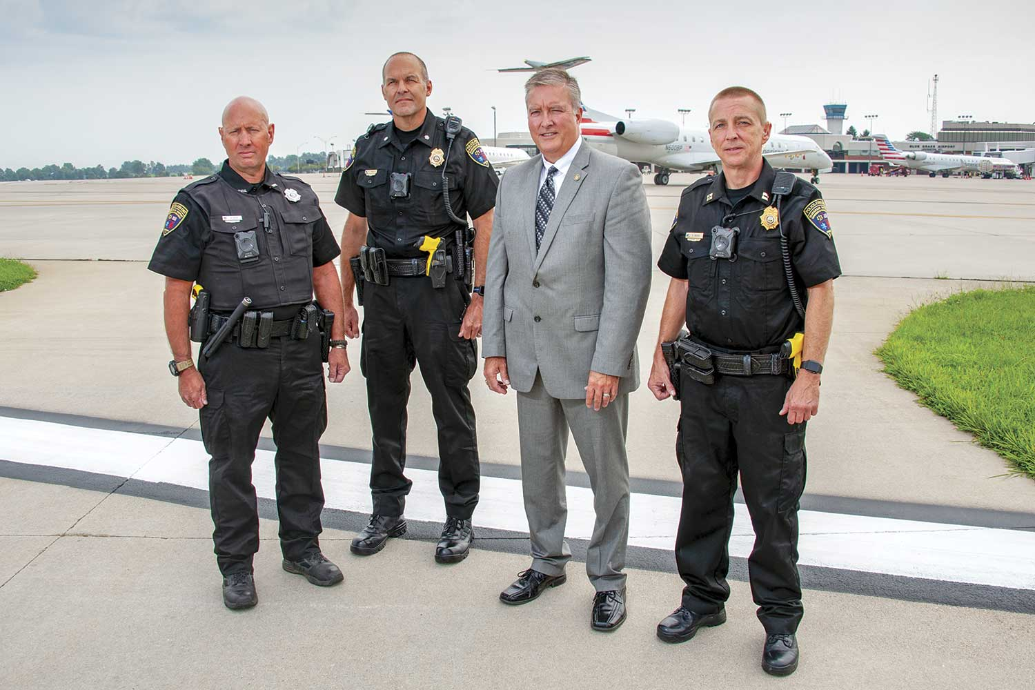From left-to-right, Blue Grass Airport Public Safety Officer Ken Ridge, Assistant Chief Paul Pungratz, Pubic Safety Director Scott Lanter and Capt. Keith Moore pose on the flight line outside the public safety facility. (Photo by Jim Robertson)