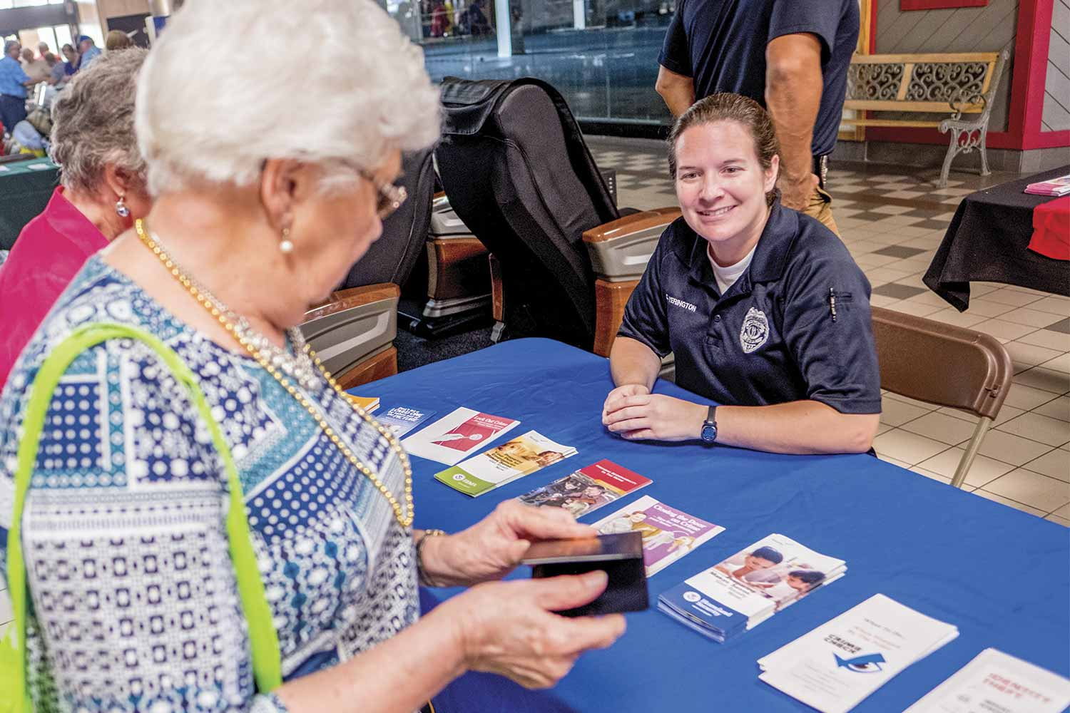 Owensboro Police Sgt. Courtney Yerington, who leads the department's Crime Prevention Unit, shared resources with citizens during a recent Senior Day Out event at Towne Square Mall. (Photo by Jim Robertson)