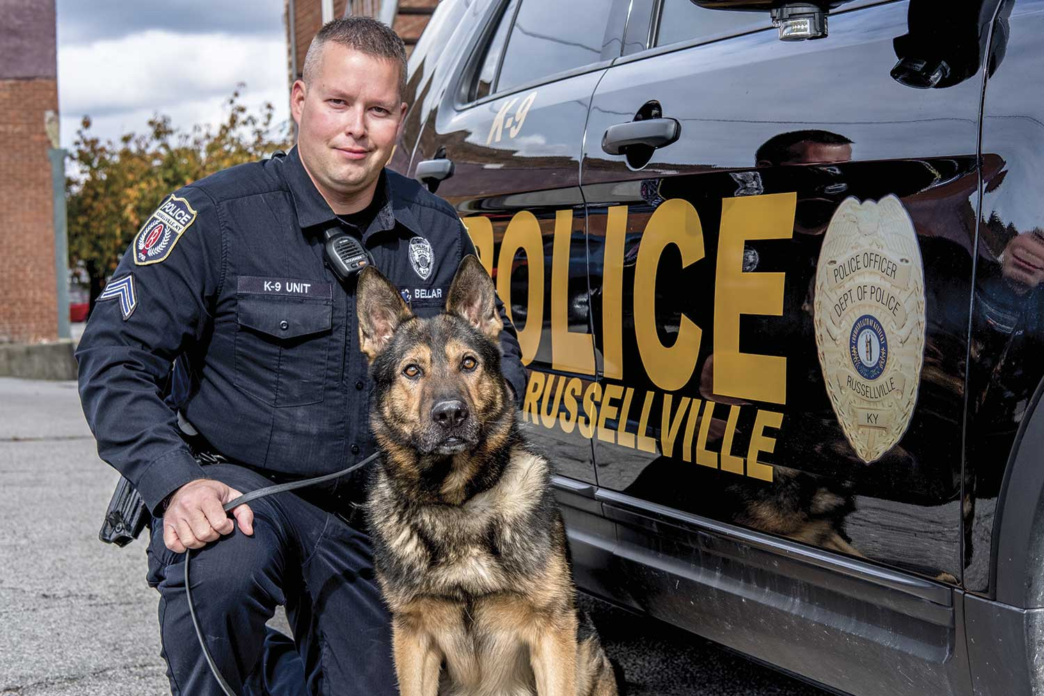 Officer Chris Bellar and his partner Jax work diligently to battle drug problems in Russellville. Police chief Victor Shifflett says many of the mental health-related calls can be traced to the drug problem. (Photo by Jim Robertson)