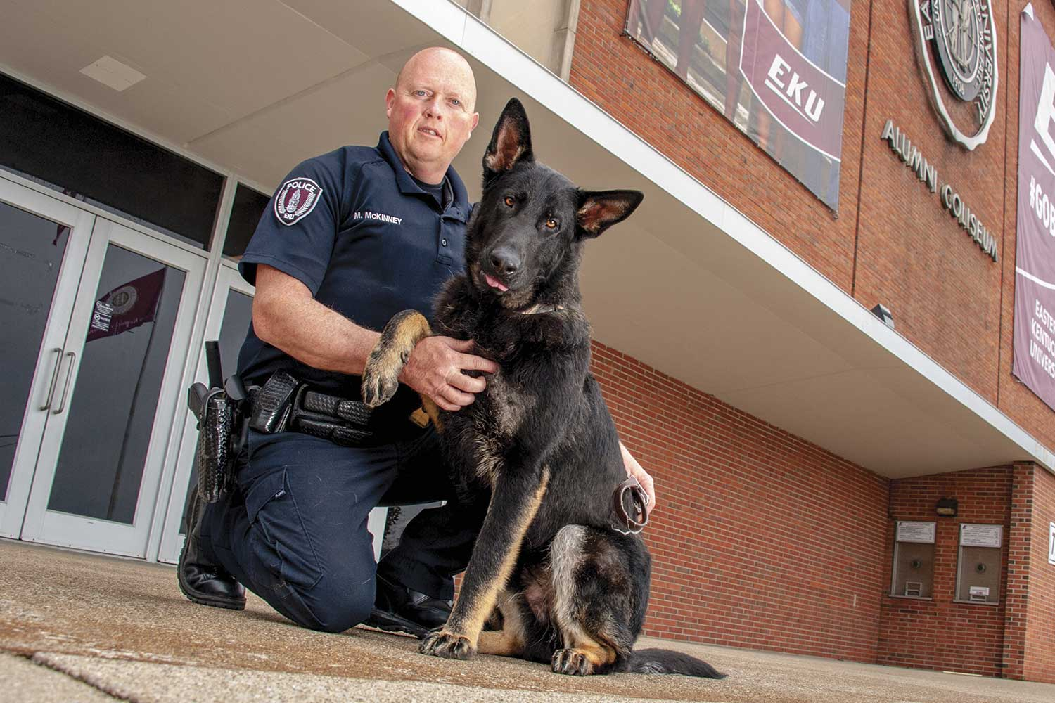 EKUPD Officer Mark McKinney is training Havoc, a 10-month-old German shephard who will be EKU's first K-9. Havoc will also be Madison County's first bomb dog. (Photo by Jim Robertson)