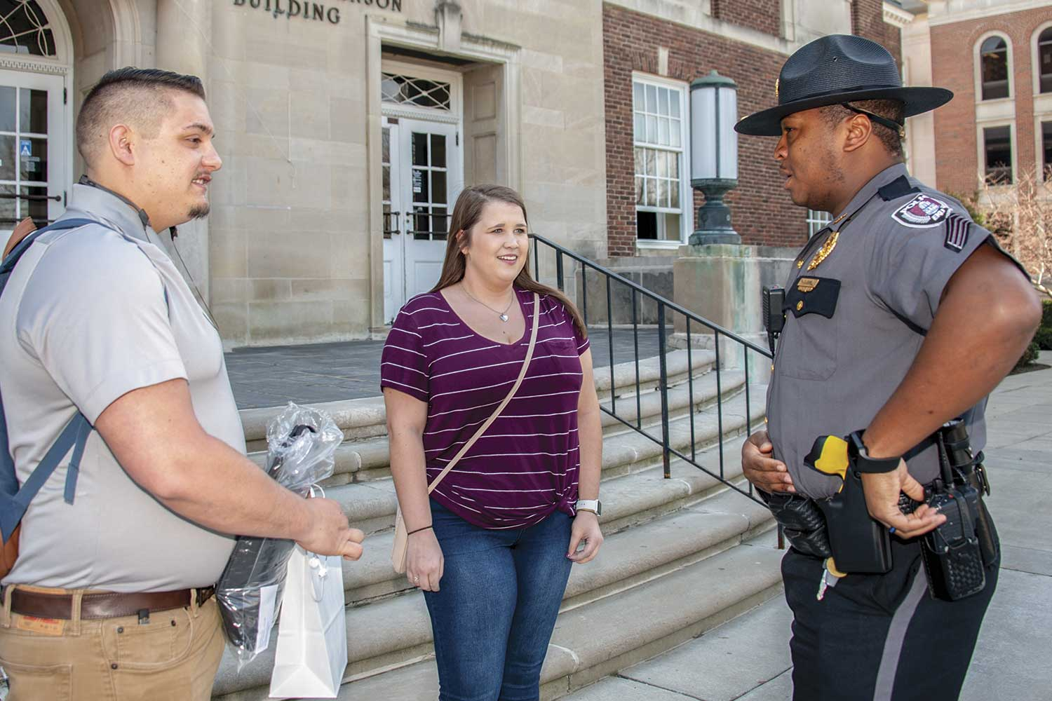 EKUPD Sgt. Tim Gunn talks with students on campus. Good communication with students, administrators and the greater campus community is essential for the police department. (Photo by Jim Robertson)