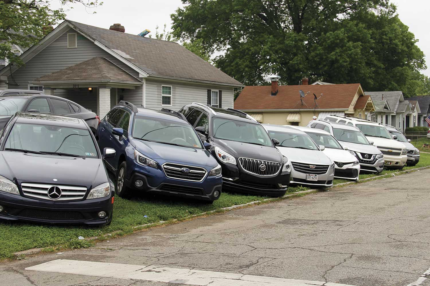 Parking at the Kentucky Derby is hard to come by. Residential areas near Churchill Downs are routinely turned into paid parking lots for those attending the Derby. (Photo by Michael A. Moore)