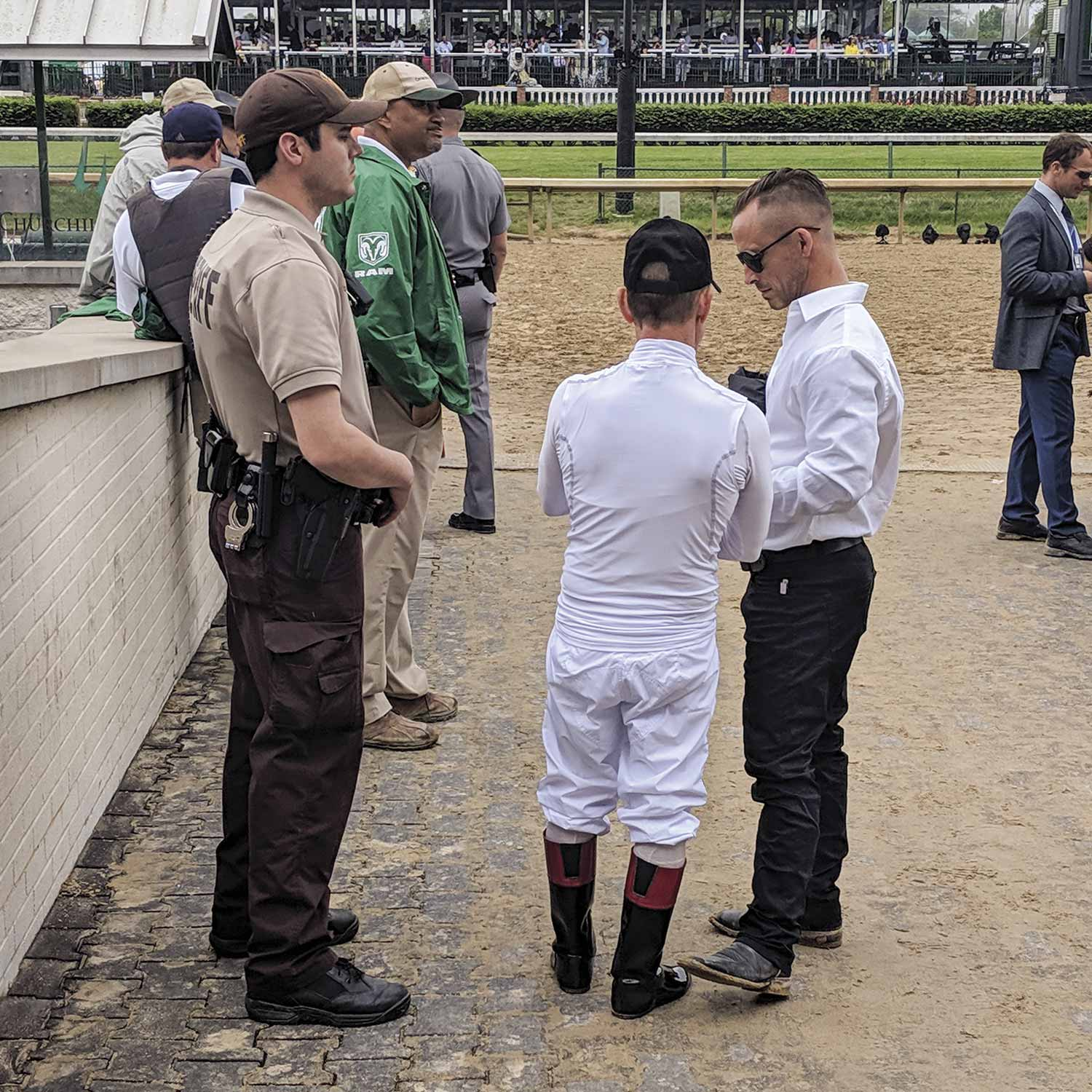A Jefferson County sheriff's deputy monitors the area around the paddock during the 2019 Kentucky Derby. JCSO is one of the many partner agencies that help out during the Derby. (Photo by Michael A. Moore)