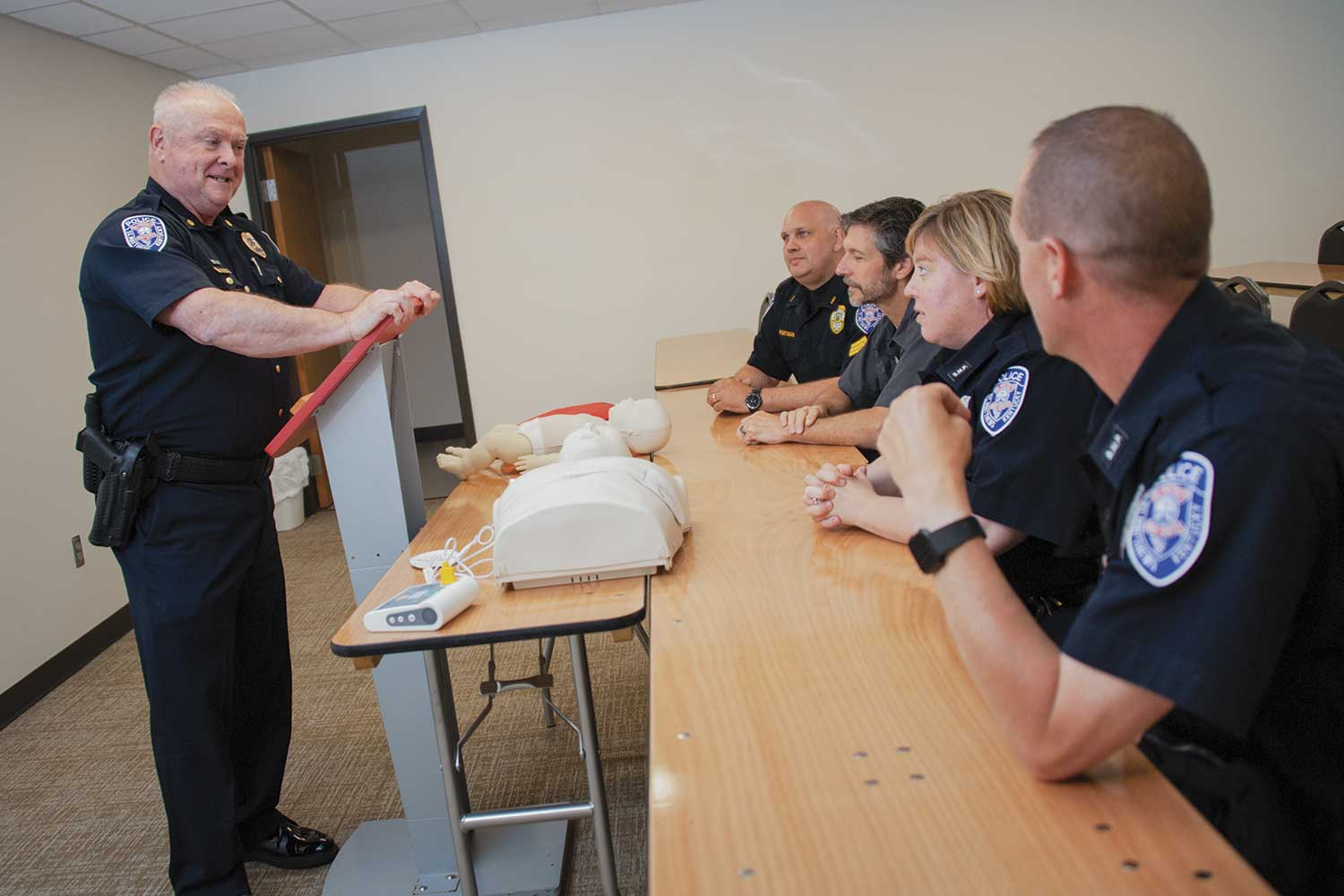 Assistant Chief and Operations Bureau Commander Tony Cobaugh instructs agency members on CPR. Under his supervision, the department has incorporated several in-house training components to enhance what officers receive at the Kentucky Department of Criminal Justice Training. (Photo by Jim Robertson)