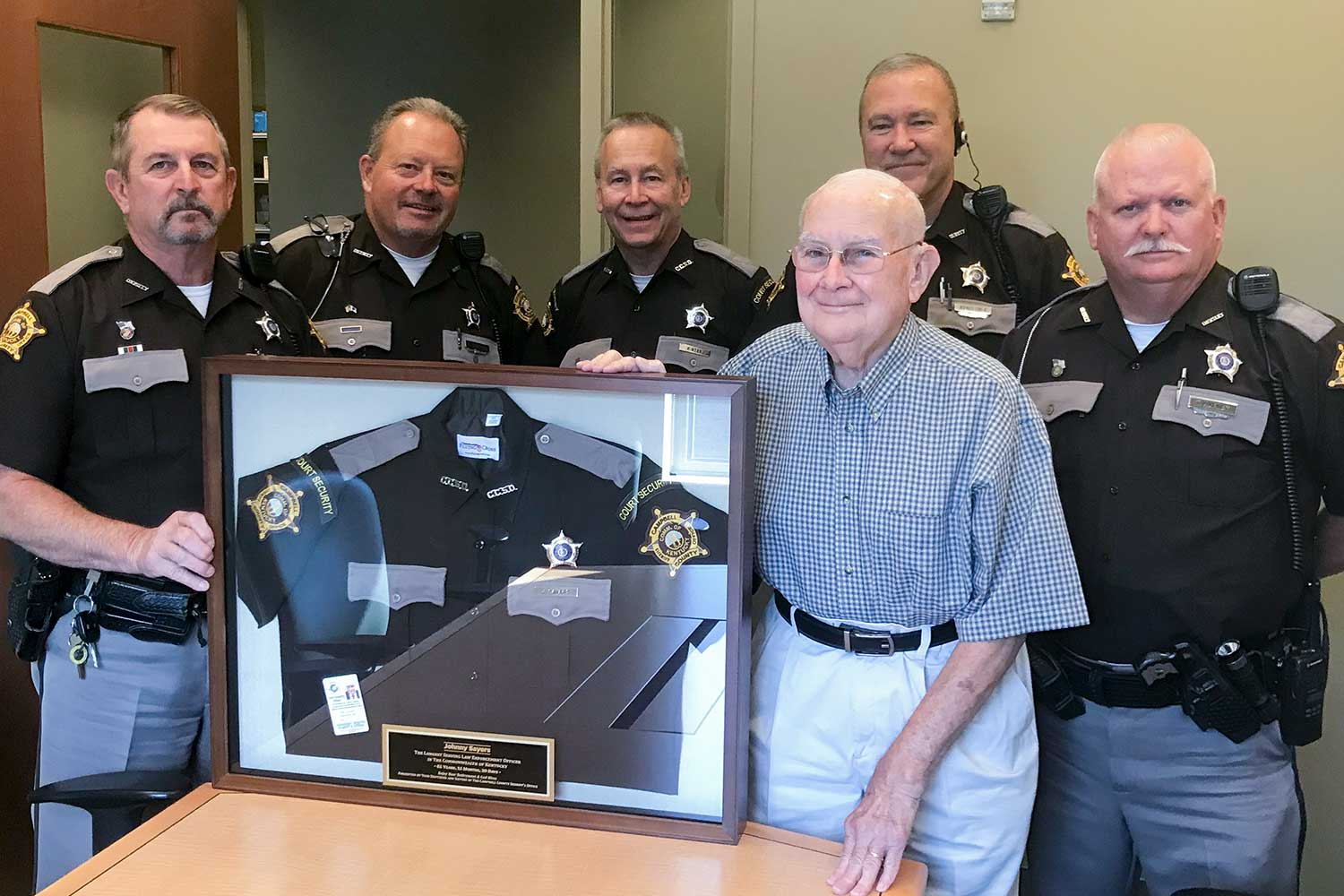 Members of the Campbell County Sheriff's Office presented retired deputy John Sayers with a his framed uniform. (Photo submitted)
