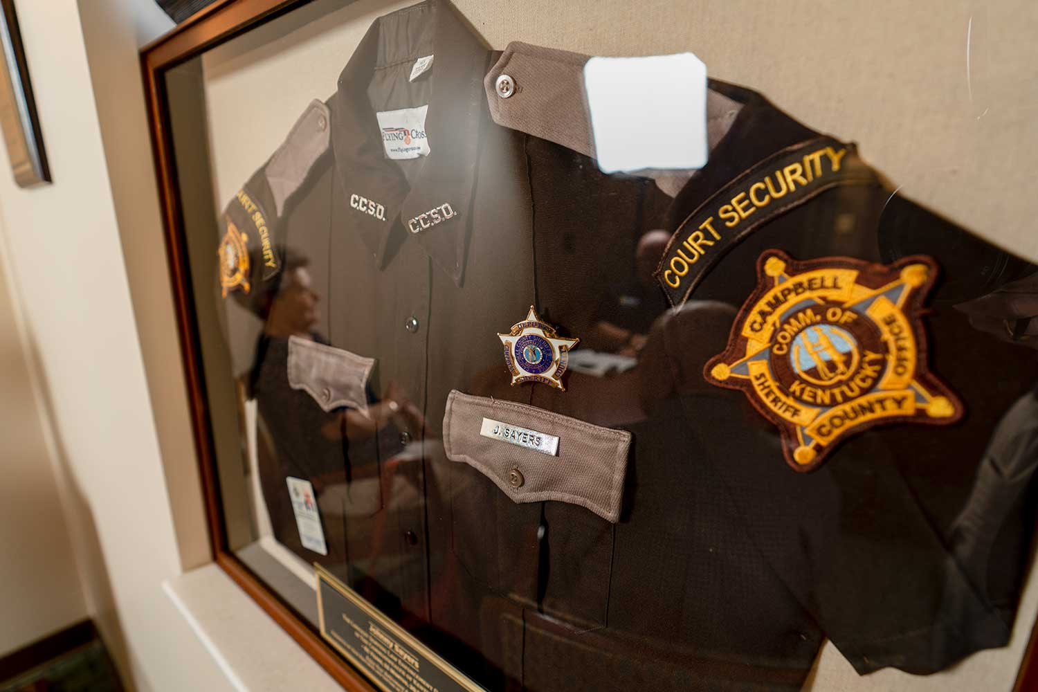 A framed Campbell County deputy's uniform was presented to retired deputy John Sayers. Sayers retired after 62 years of service to Campbell County and Silver Grove, Ky. (Photo by Jim Robertson)