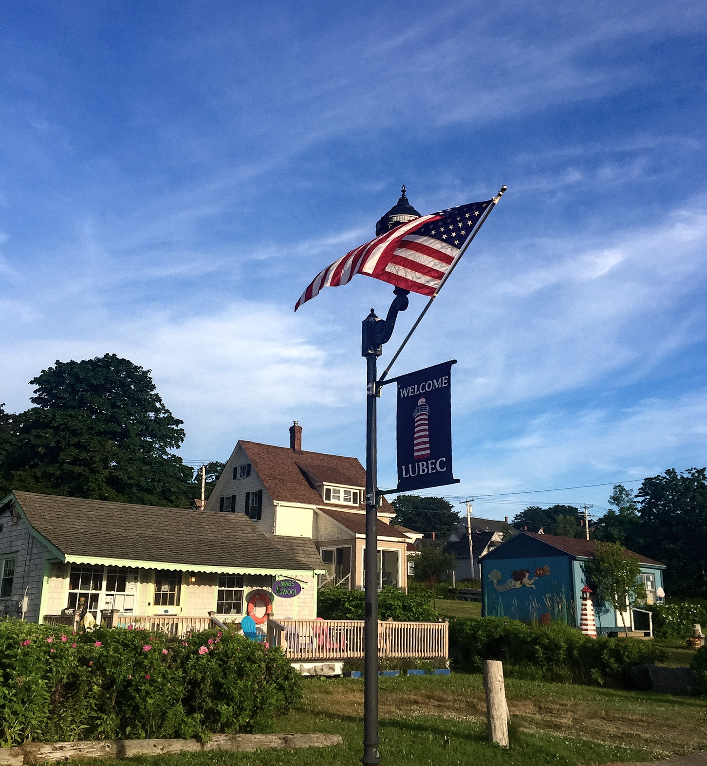 The cheery morning sun illuminates the small shops which line downtown Lubec's Water Street.