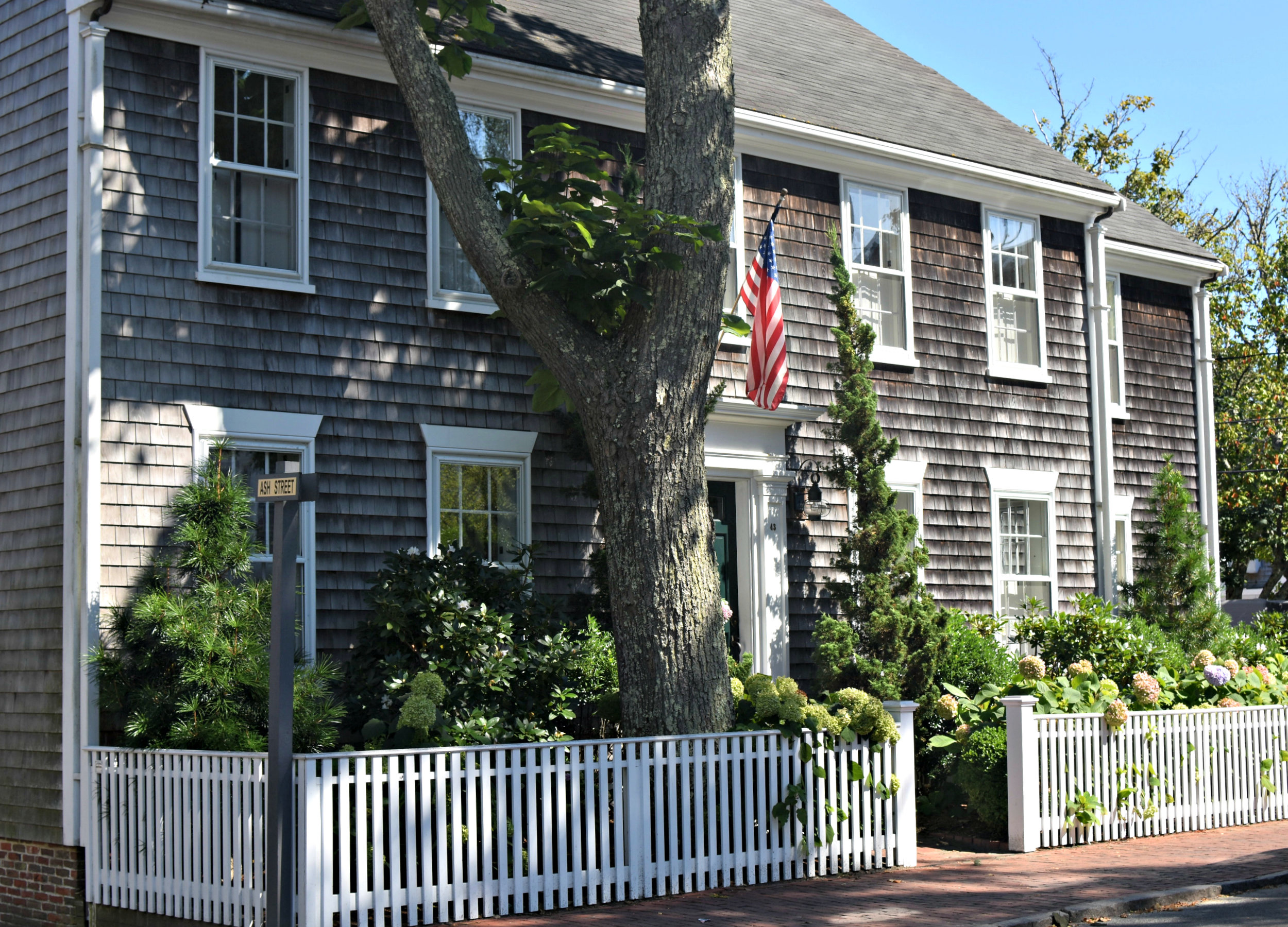 Most island homes are covered in unpainted cedar shingles, which lose their golden color and weather to a silvery gray after their first Nantucket winter.