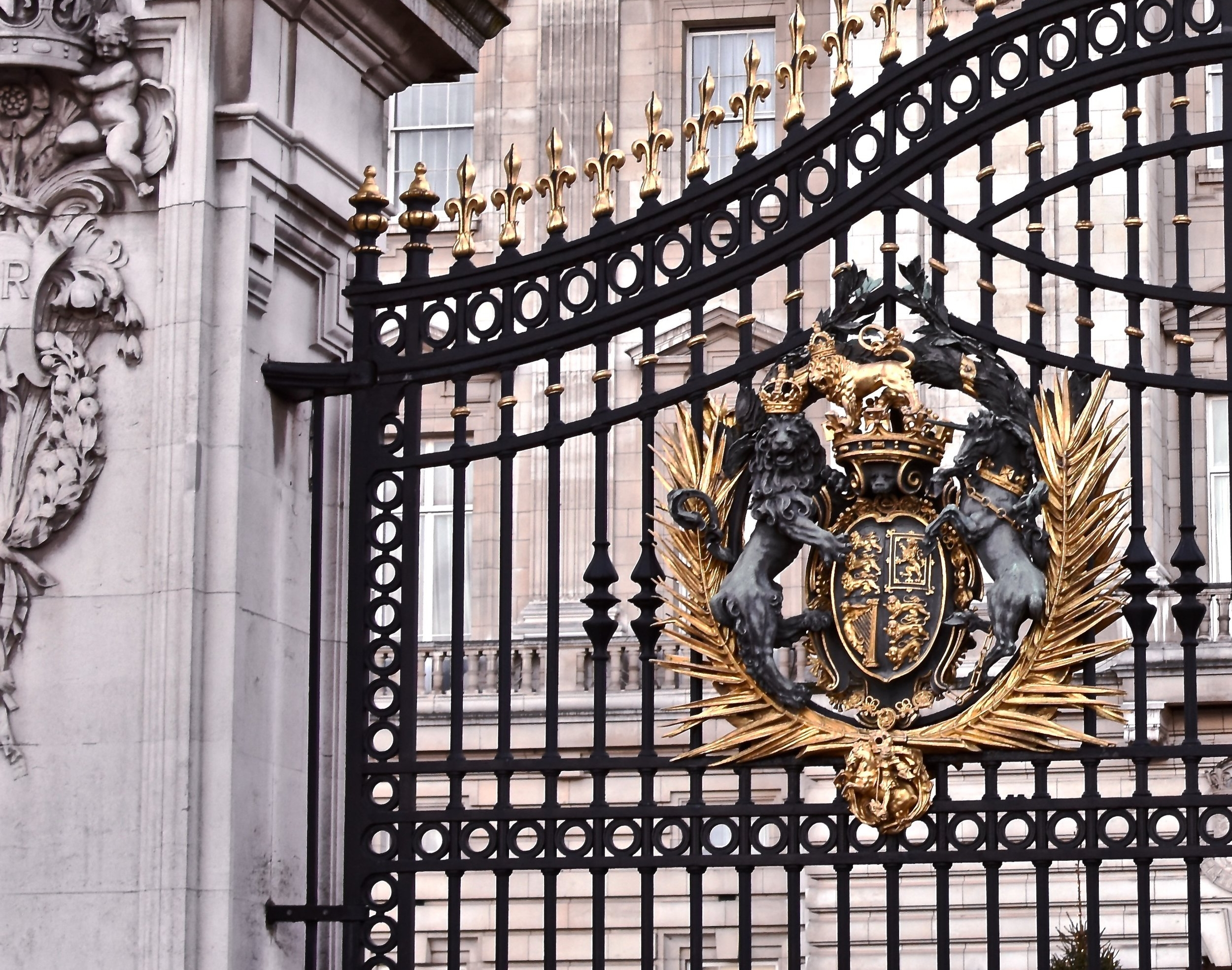 Flanked by an English lion on the left and Scottish unicorn on the right, the Royal coat of arms of the United Kingdom adorn the gates of Buckingham Palace.  As the official coat of arms of the British monarch, the Royal Arms as shown above may only be used by the Queen herself.