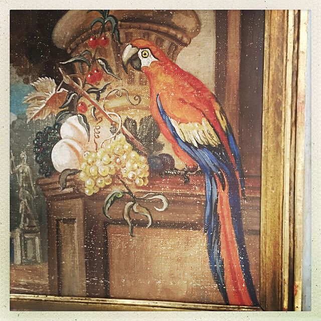 "Primitive Louis XVI #Trumeau featuring a painted linen panel of a #macaw and Summer fruits in a park. The piece measures 31.5""w x 71.5""h x 1""d."