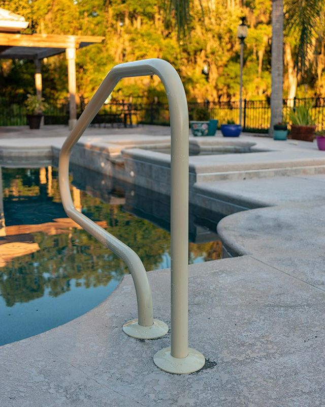 The homeowner wanted some more safety and assistance getting in and out of their pool and this was how we've tried to help them. Everyone should be able to feel safe and enjoy their pools any time so however we can help makes us feel incredibly proud . The acrylic hand rails are much simpler for us to install saving you money. We also believe they are the best option in terms of aesthetics because we can match them to the paint and overall theme of back yards helping them to blend in more when you are on the back porch enjoying the view . If you'd like to enjoy your pool more we highly recommend you get a handrail for some peace of mind and confidence in staying safe