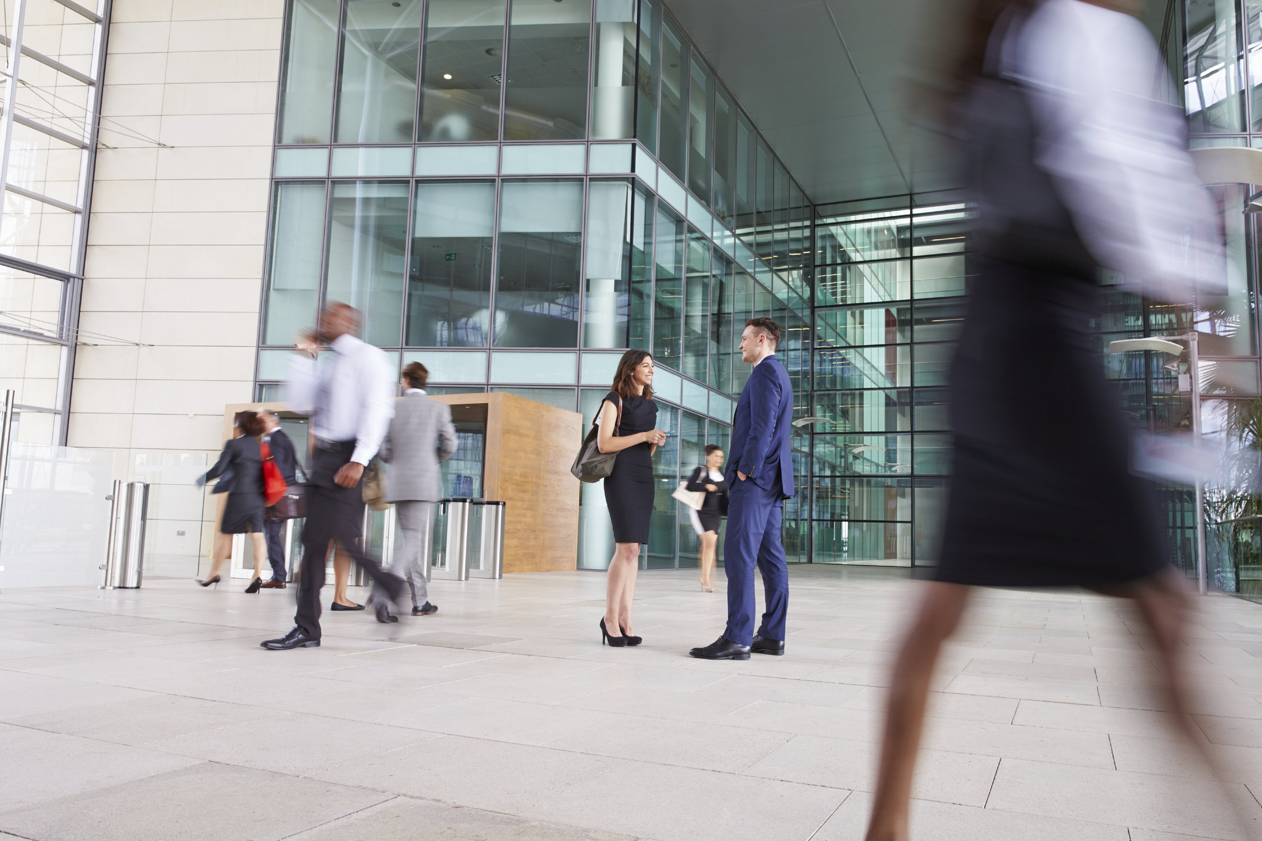 People-passing-through-the-busy-foyer-of-a-business-building-000073538383_Full.jpg