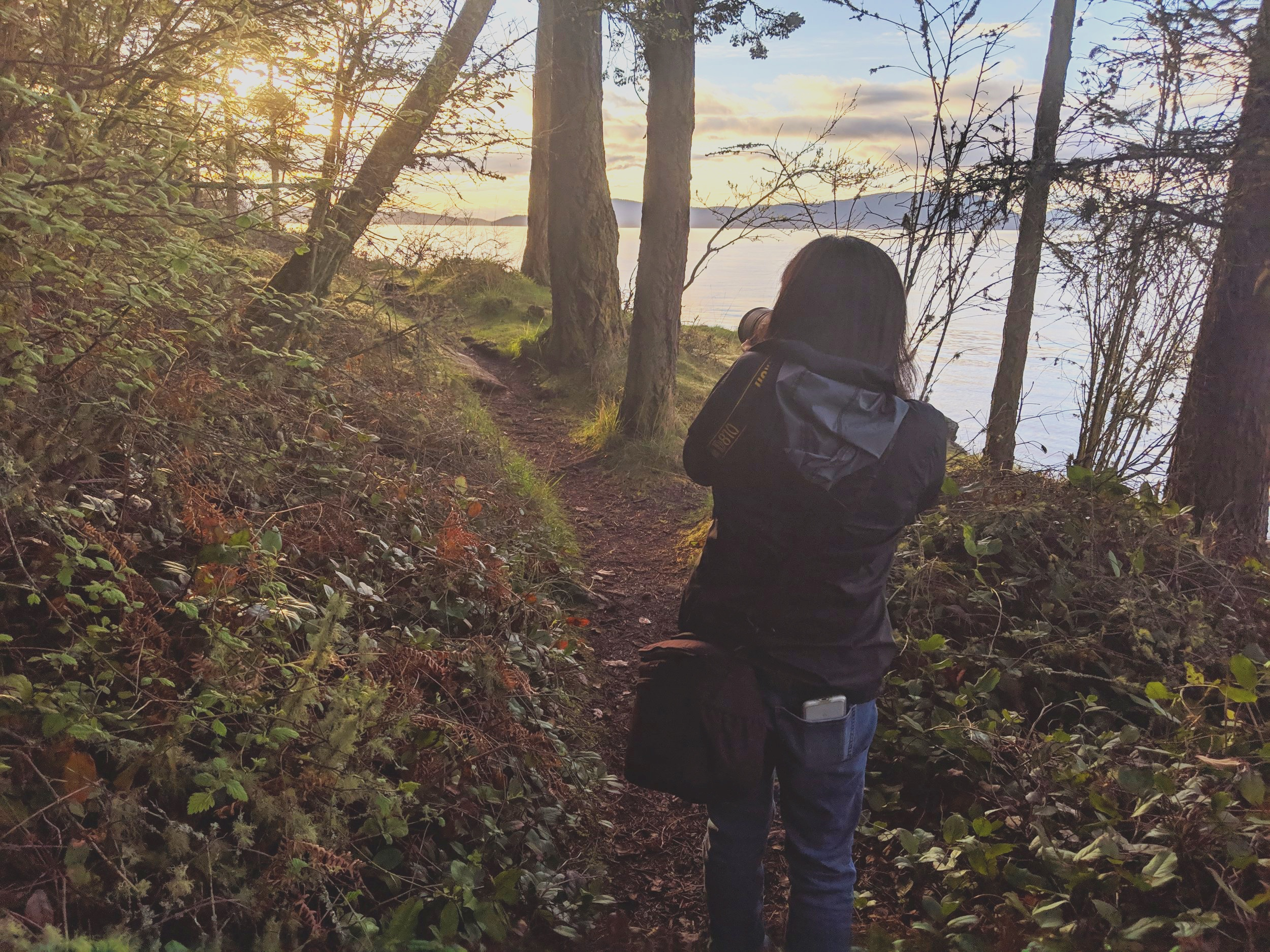 Mary Parkhill photographing the sunset over the San Juan Islands