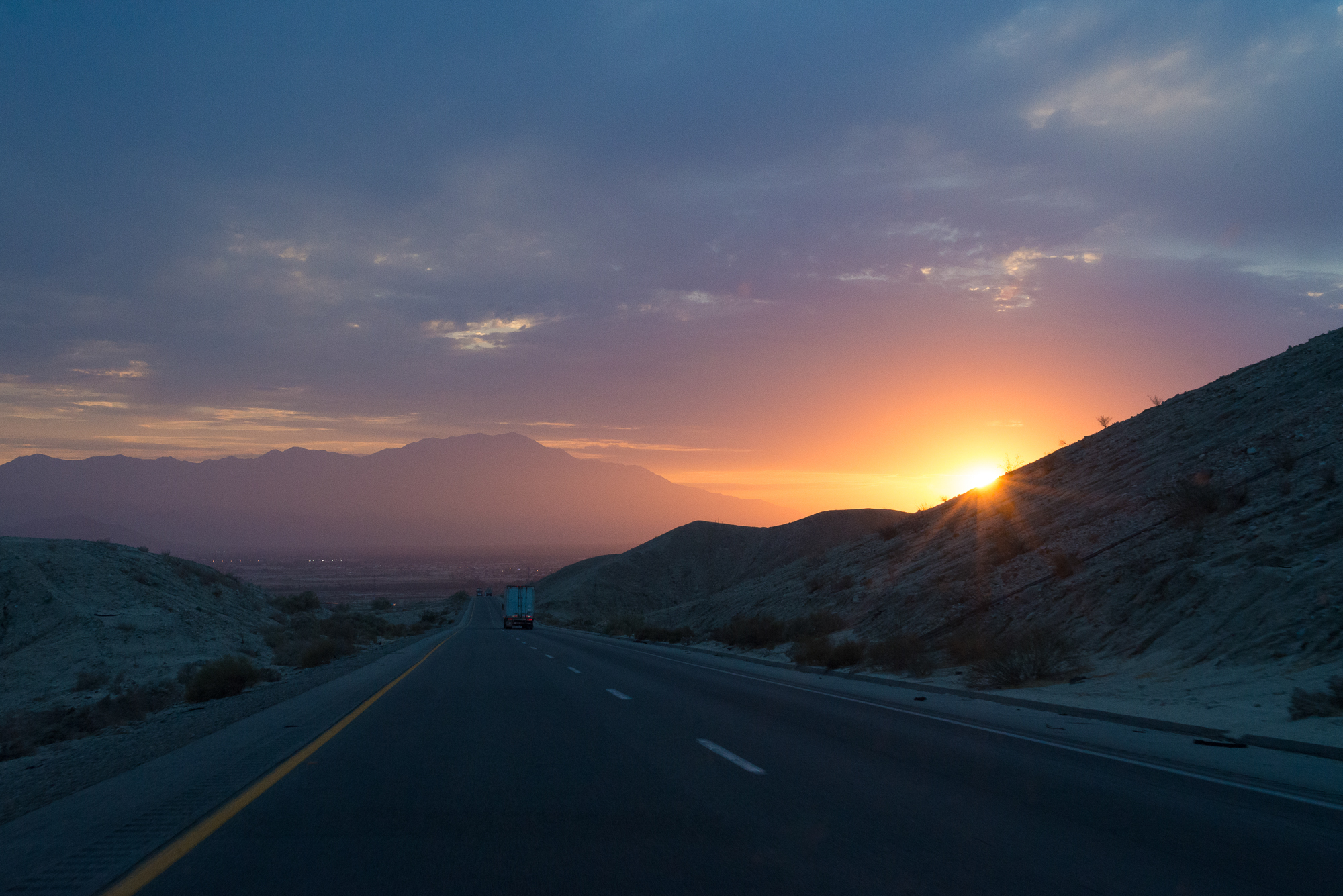 Sunset on the highway outside of Palm Desert, CA