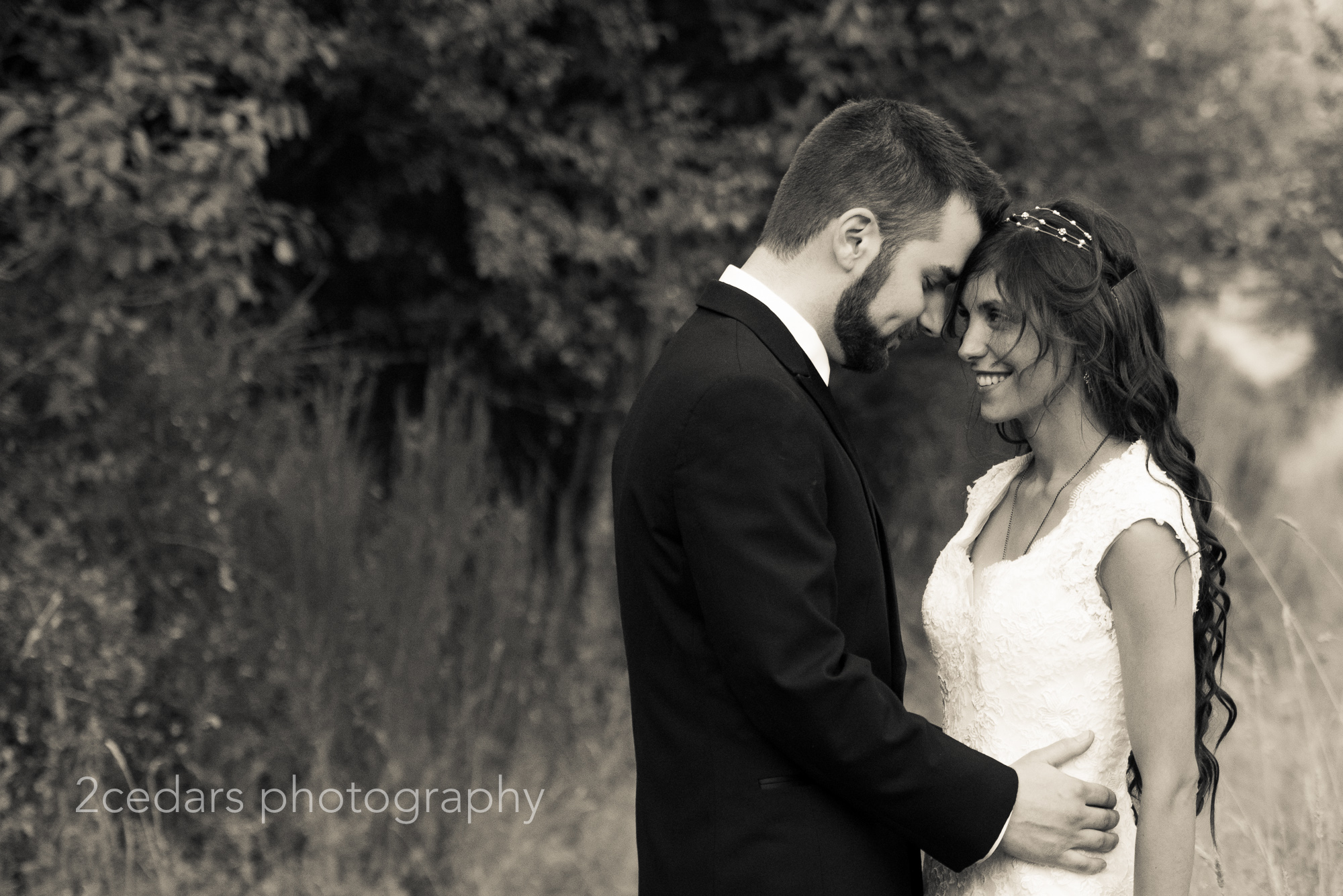 Black and white bride and groom documentary style portrait