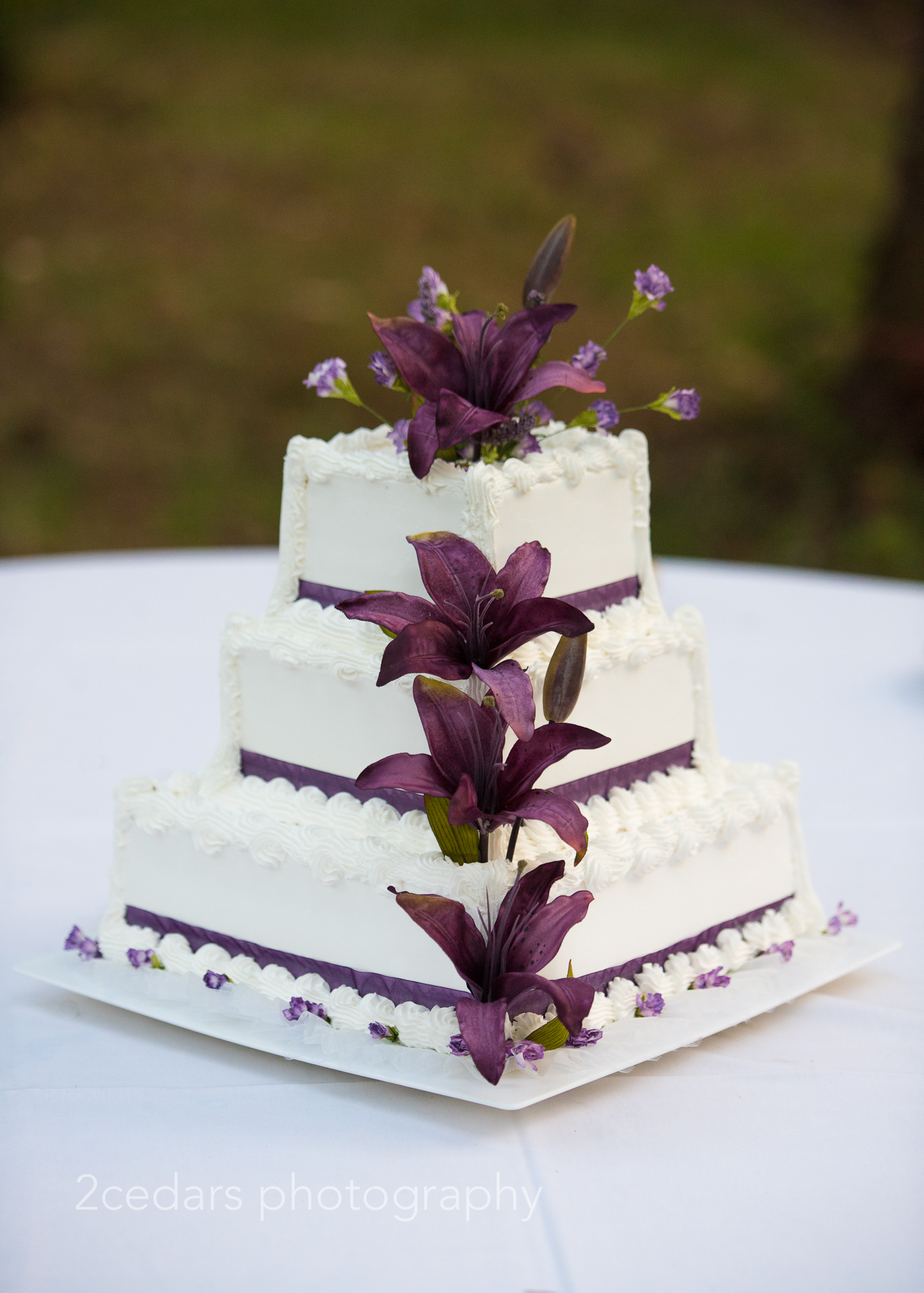 Purple lily wedding cake Pacific Northwest outdoor wedding